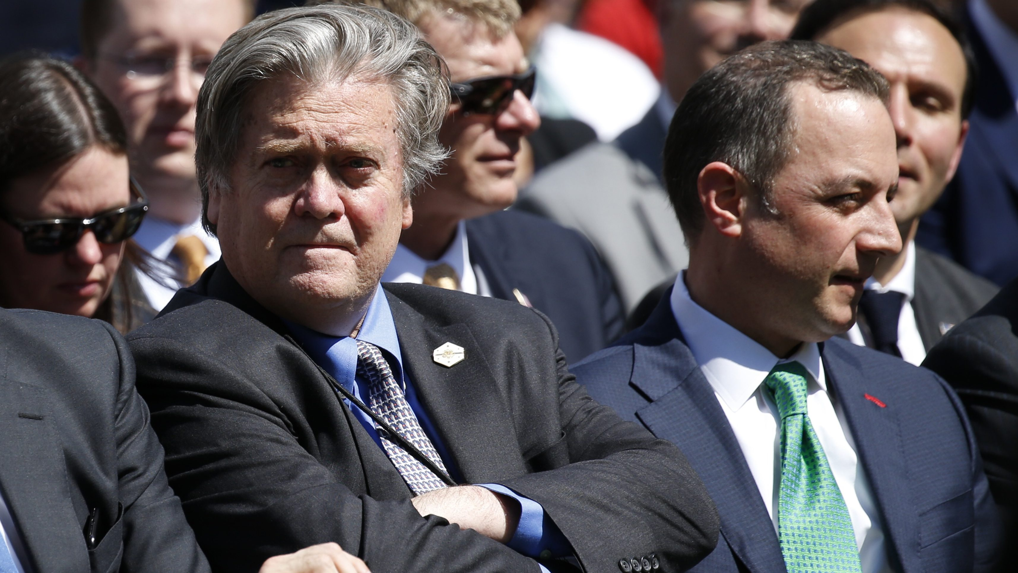 White House Chief Strategist Stephen Bannon (L) and Chief of Staff Reince Priebus (R) wait in the Rose Garden prior to U.S. President Donald Trump announcing his decision on whether the U.S. will remain in the Paris Climate Agreement, at the White House in Washington, U.S., June 1, 2017. REUTERS/Joshua Roberts - RTX38LIY