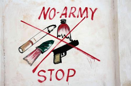 An illustration prohibiting weapons, broken bottles, cigarettes and military is seen on a wall of a stadium in Hodan district of Mogadishu, Somalia, June 13, 2017.