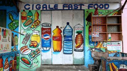 A mural on the wall of a fast food store illustrates food and drinks in Wabari district of Mogadishu, Somalia.