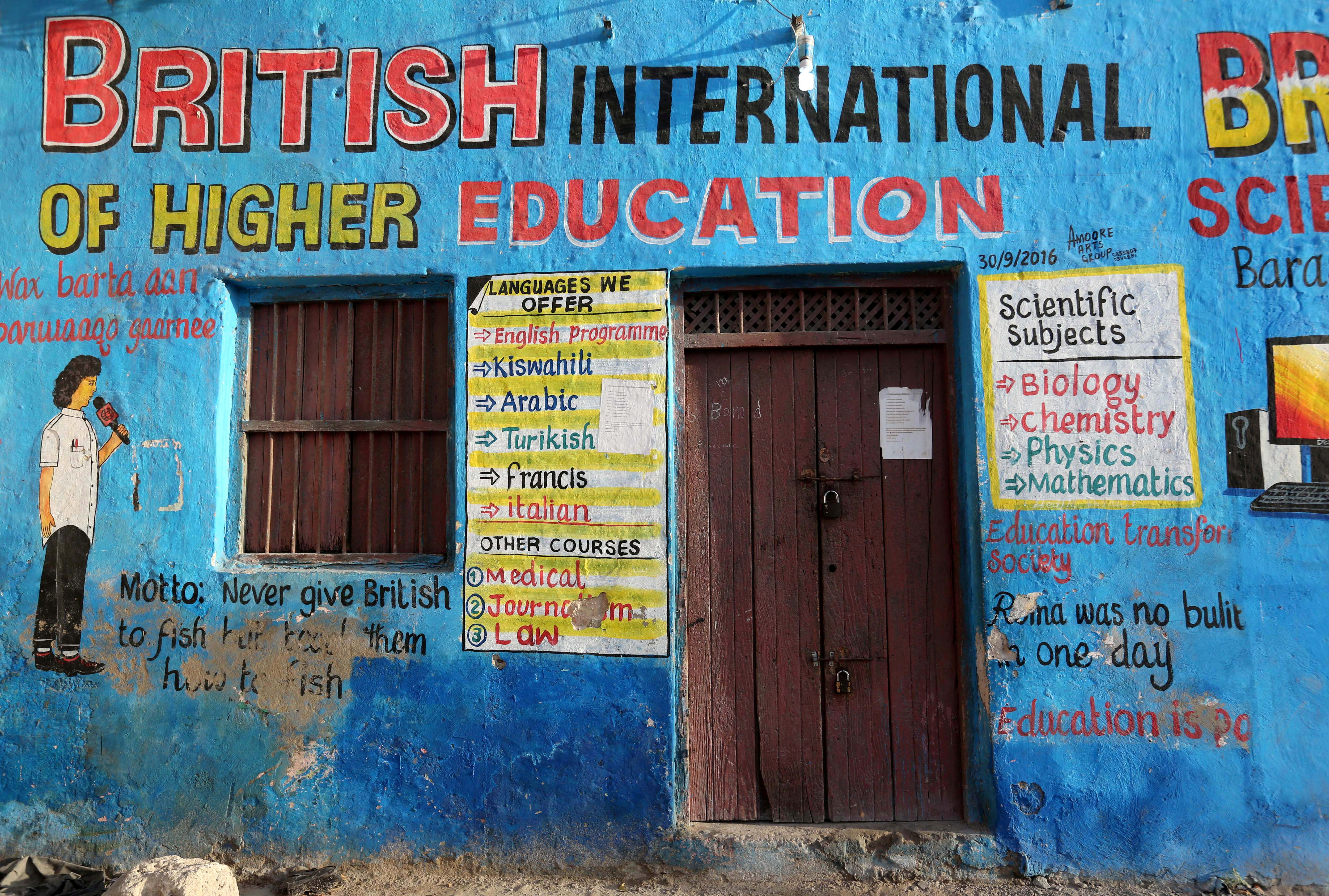 A mural illustrating educational classes is seen on the outside of a building in Wabari district of Mogadishu, Somalia, June 10, 2017.