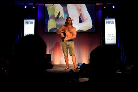 Chase Ferrel with Urban Carry Holsters displays a concealed hip holster during the National Rifle Association (NRA) Carry Guard Expo Fashion Show in Milwaukee, Wisconsin, U.S., August 25, 2017. REUTERS/Ben Brewer - RTX3DDLY