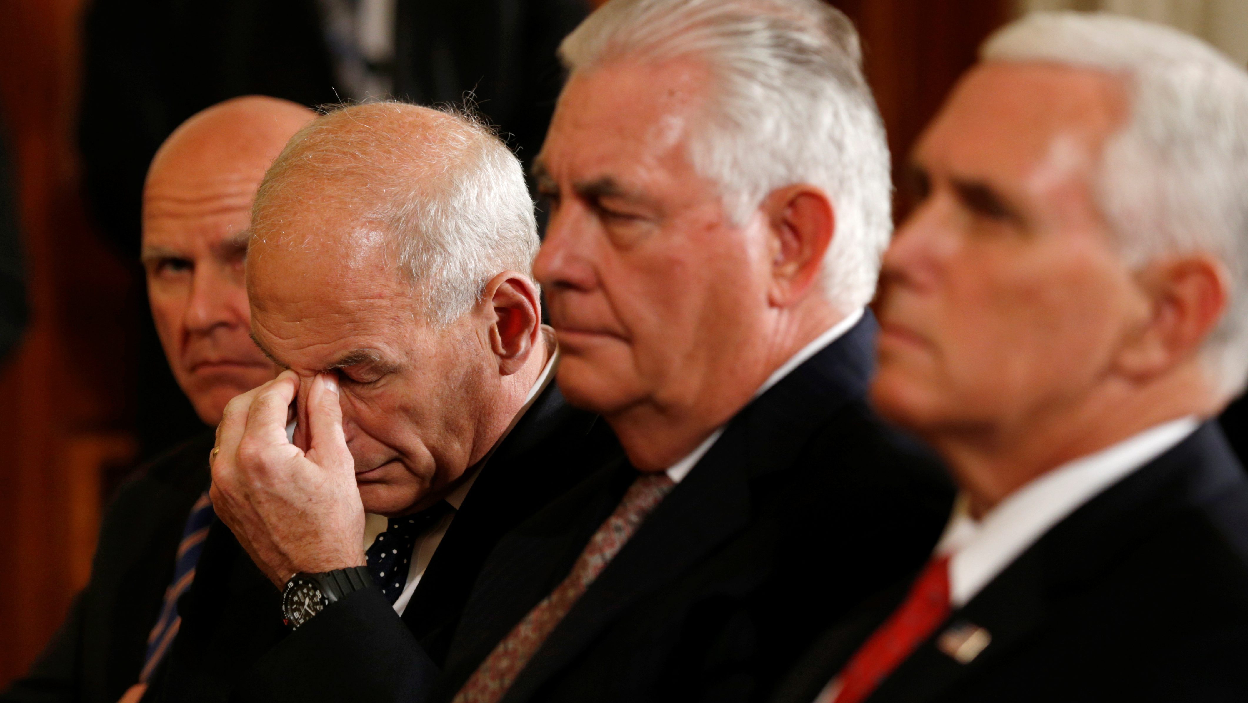 White House Chief of Staff John Kelly (2nd L) wipes his eyes while seated with National Security Adviser H.R. McMaster (L) U.S. Secretary of State Rex Tillerson (2nd R) and Vice President Mike Pence as U.S. President Donald Trump holds a joint press conference with Finnish President Sauli Niinisto at the White House in Washington, U.S., August 28, 2017.