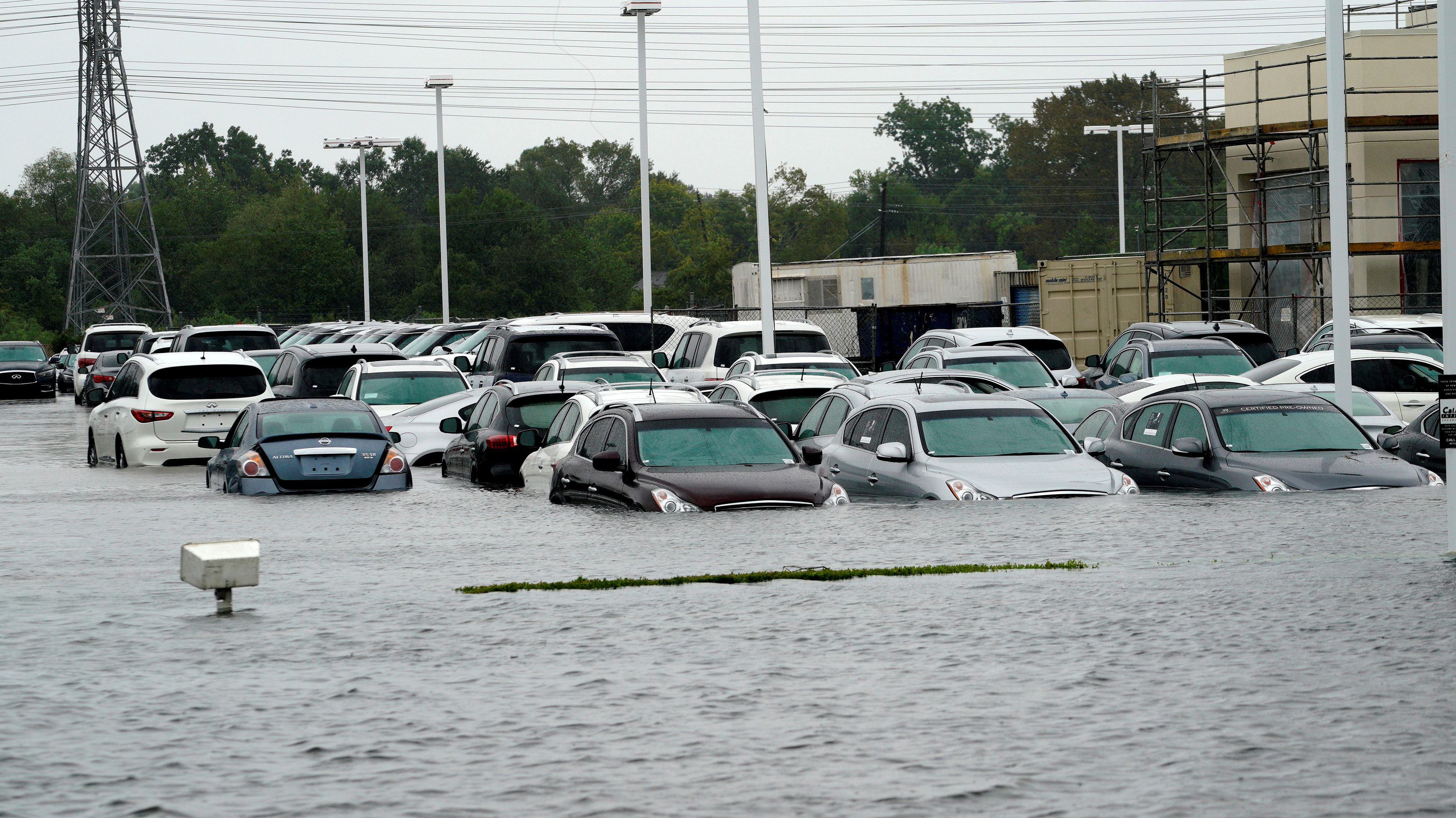 A car dealership is covered by Hurricane Harvey floodwaters near Houston, Texas August 29, 2017. REUTERS/Rick Wilking - RC14BD462170
