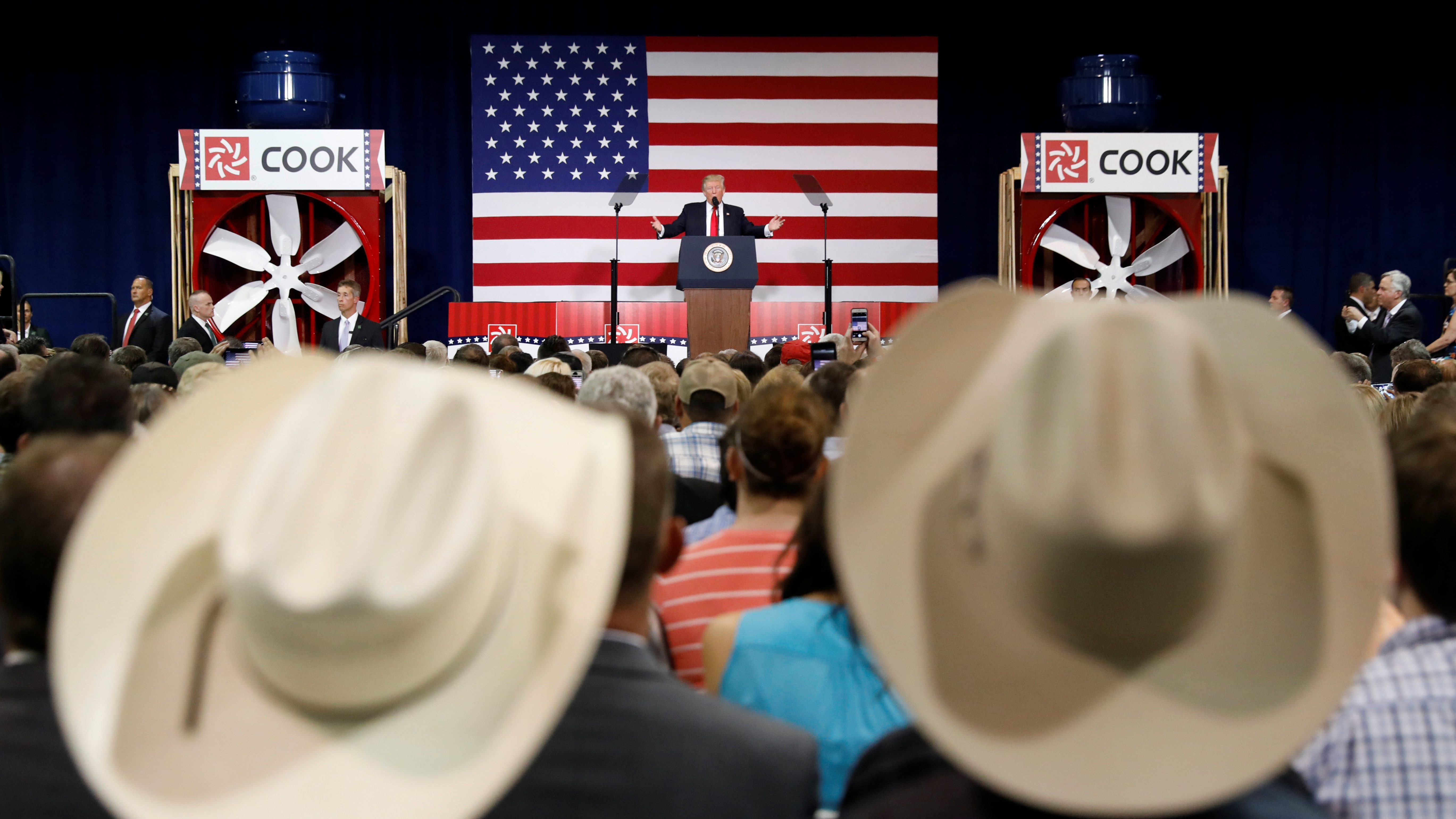 Supporters wearing cowboy hats listen as U.S. President Donald Trump speaks about tax reform during a visit to Loren Cook Company in Springfield, Missouri, U.S., August 30, 2017. REUTERS/Kevin Lamarque - RTX3E1WV