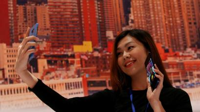 A guest poses with a new Galaxy Note 8 smartphone during the company's launch event in New York City, U.S., August 23, 2017.