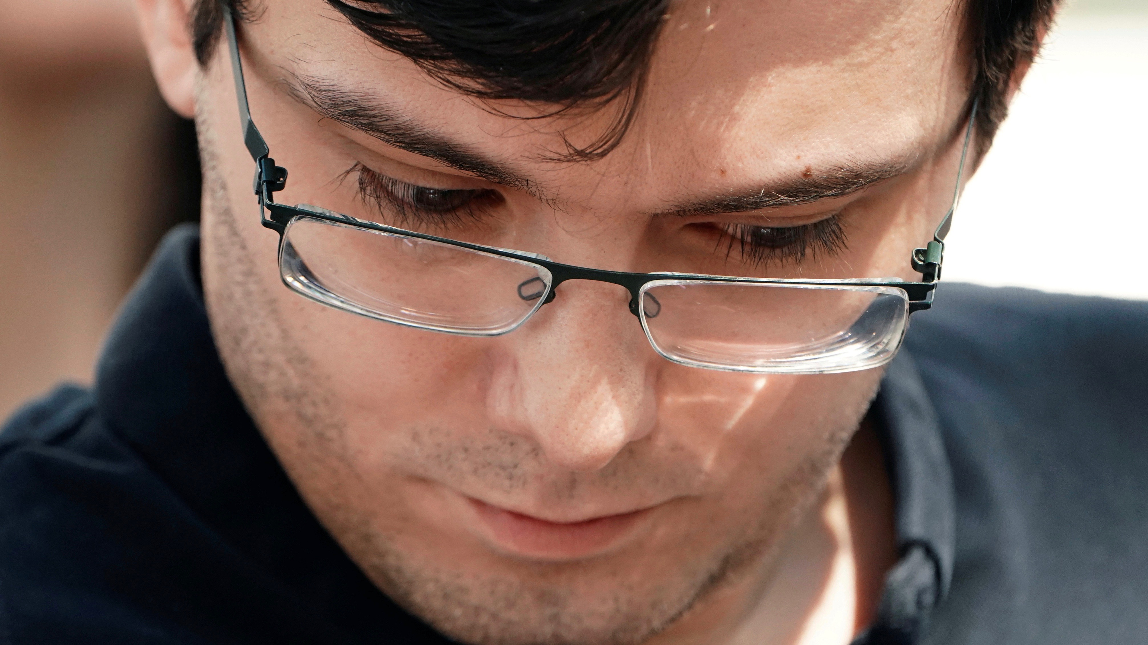 Martin Shkreli exits New York court after conviction.