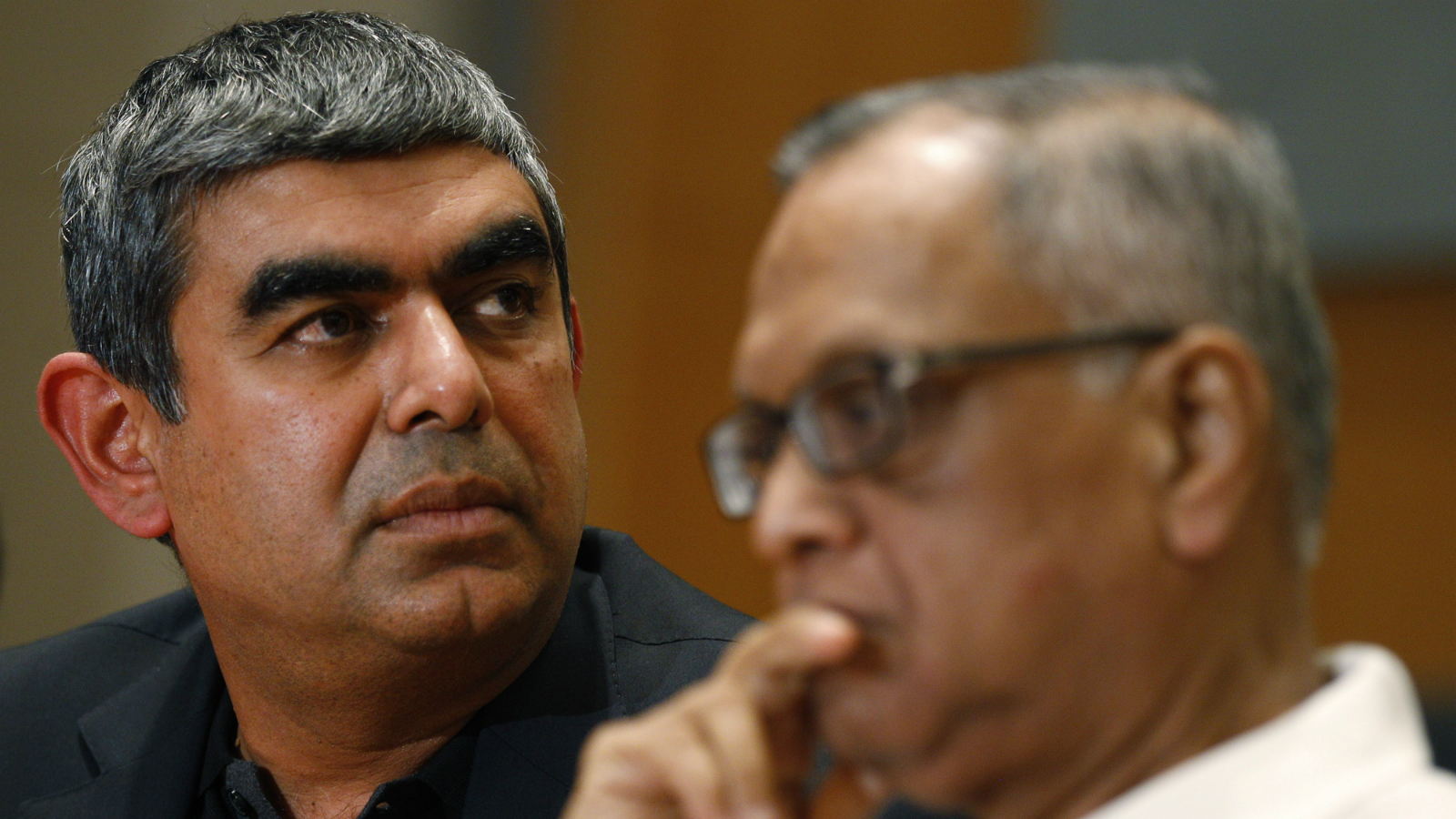 "Infosys new Chief Executive Officer and Managing Director designate Vishal Sikka, left, and Chairman N.R. Narayana Murthy listen to a question during a press conference at the company's headquarters in Bangalore, India, Thursday, June 12, 2014. Sikka said Thursday he felt honored to lead India's second-largest technology outsourcer and was looking forward to working with ""talented Infoscions"" around the world. ()"