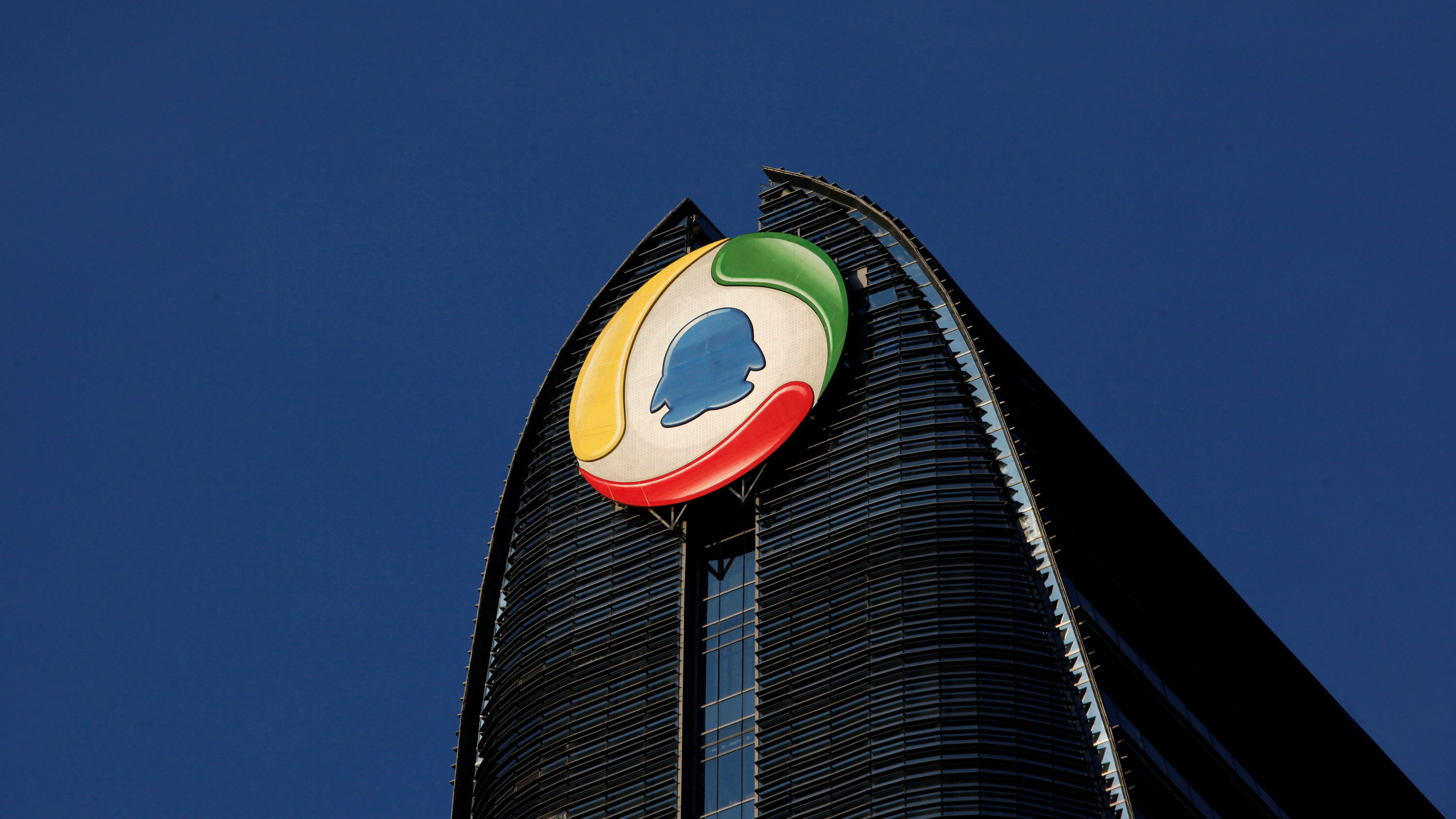 The logo of QQ.com is seen at Tencent headquarters at Nanshan Hi-Tech Park Industrial Park in the southern Chinese city of Shenzhen June 9, 2011.
