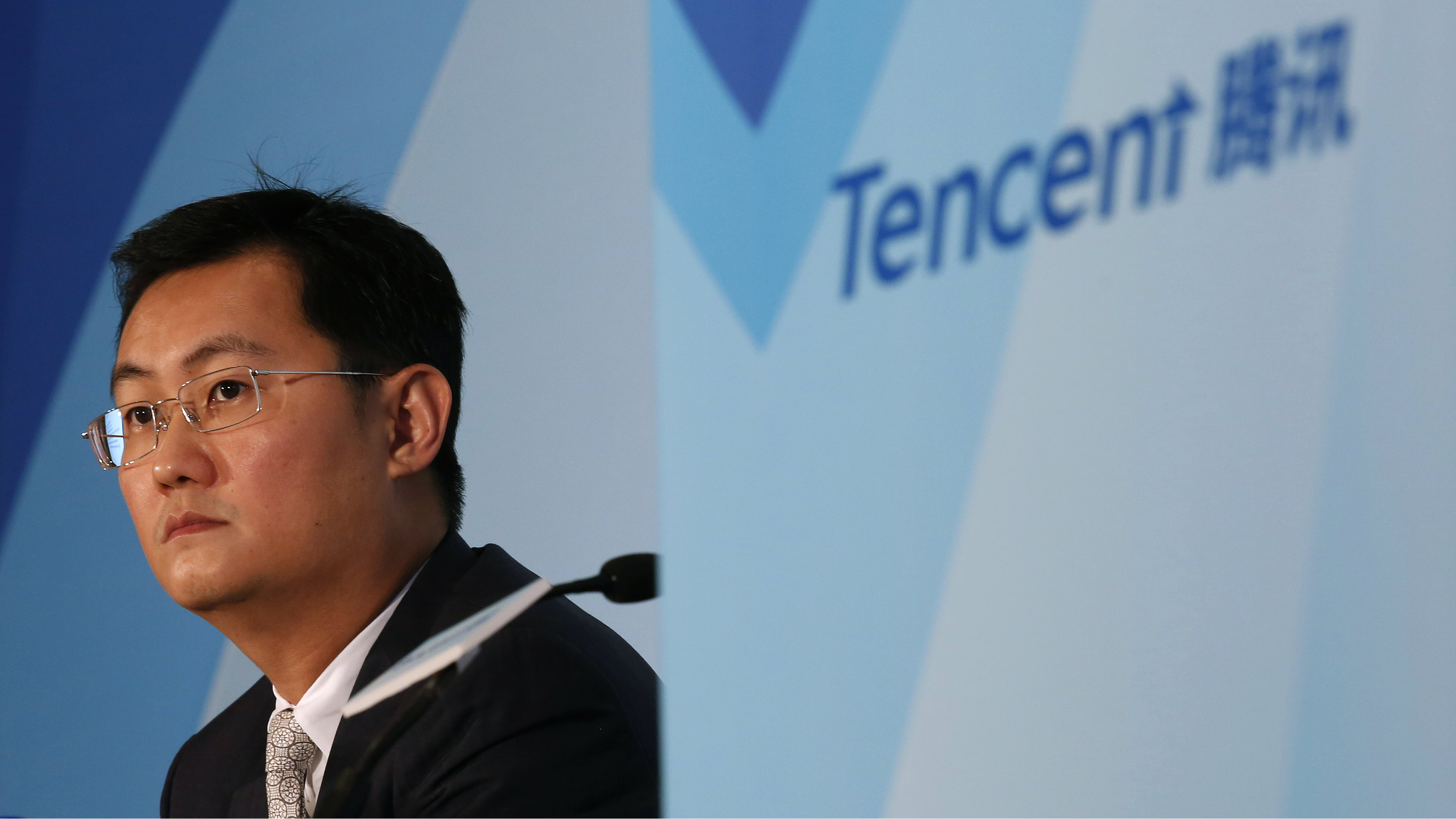 Tencent Chairman & Chief Executive Officer Pony Ma attends a news conference announcing the company's results in Hong Kong March 18, 2015. Tencent Holdings Ltd , China's biggest social network and online entertainment firm, posted a 51 percent gain in fourth-quarter net income, missing estimates, as sharing and content costs took a bite out of healthy revenue growth.