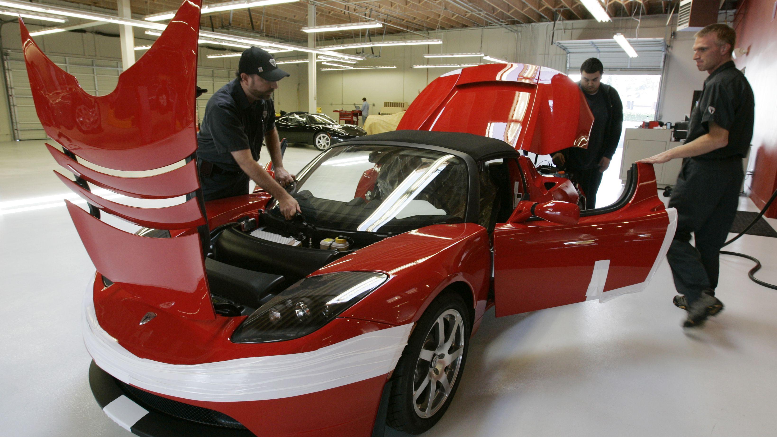 Car mechanic hard at work