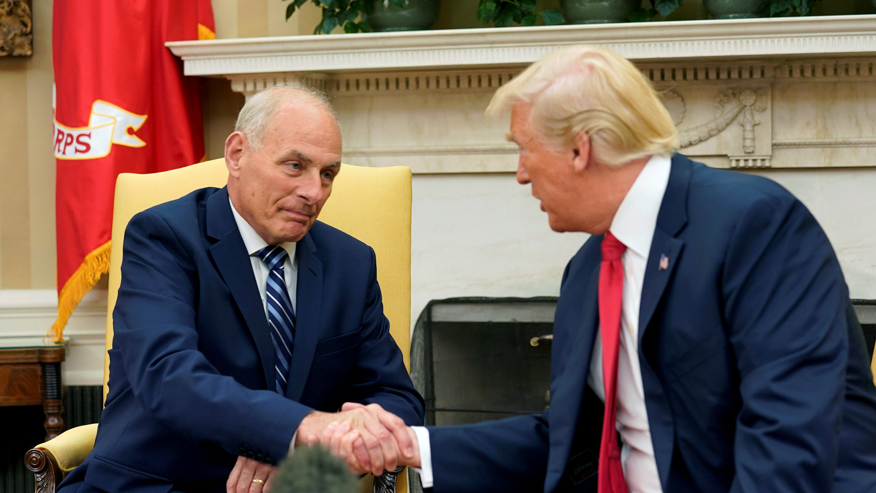 U.S. President Donald Trump shakes hands with John Kelly after he was sworn in as White House Chief of Staff in the Oval Office of the White House in Washington, U.S., July 31, 2017. REUTERS/Joshua Roberts TPX IMAGES OF THE DAY