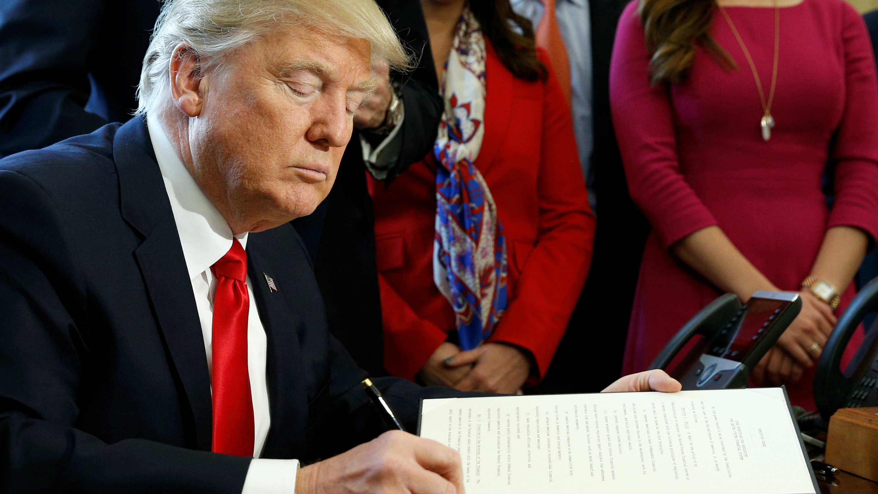 U.S. President Donald Trump signs an executive order rolling back regulations from the 2010 Dodd-Frank law on Wall Street reform at the White House in Washington, U.S. February 3, 2017.