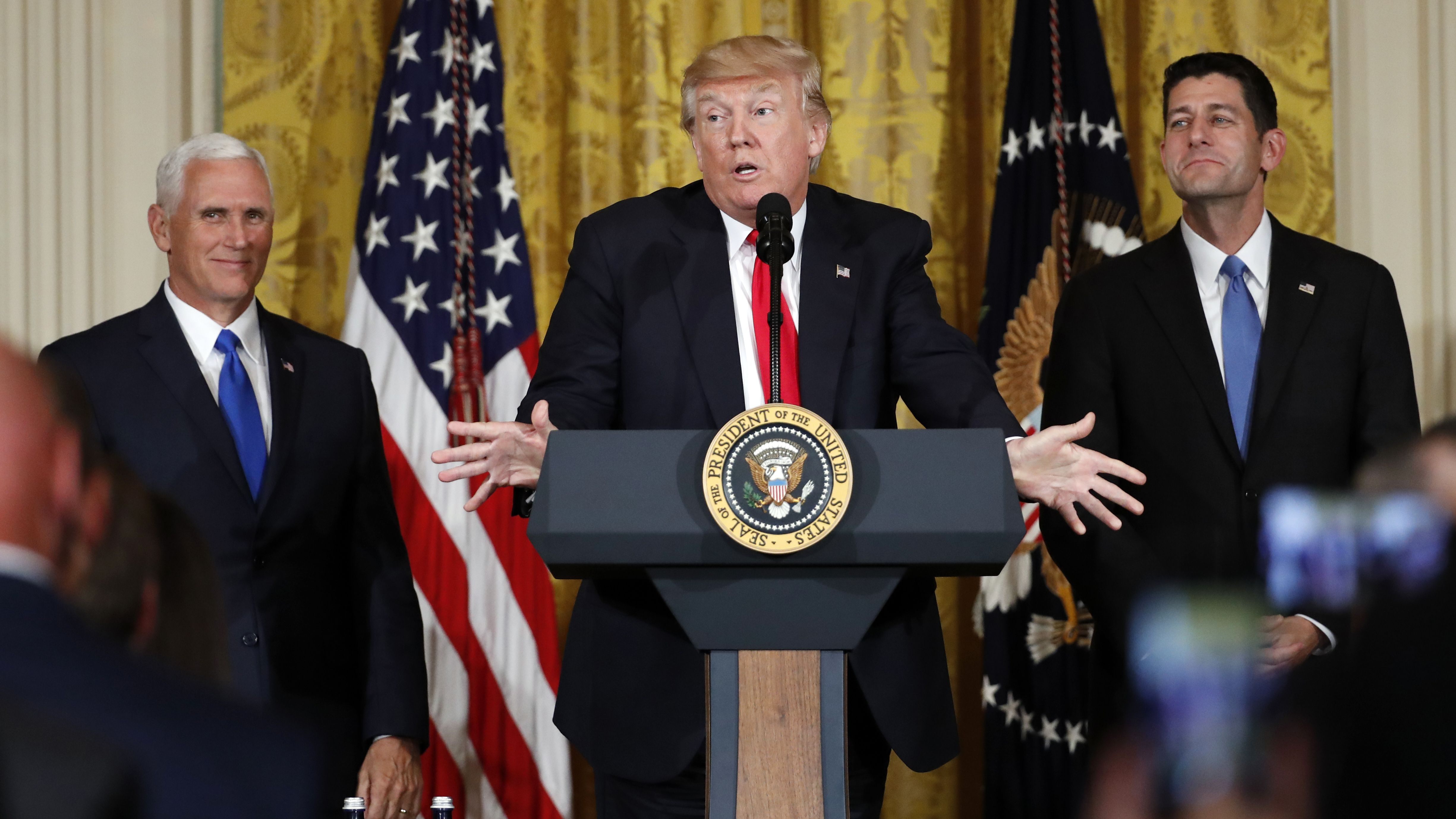 President Donald Trump, accompanied by Vice President Mike Pence, and House Speaker Paul Ryan of Wis., gestures while speaking in the East Room of the White House, Wednesday, July 26, 2017, in Washington. Trump is announcing the first U.S. assembly plant for electronics giant Foxconn in a project that's expected to result in billions of dollars in investment in the state and create thousands of jobs. (AP Photo/Alex Brandon)