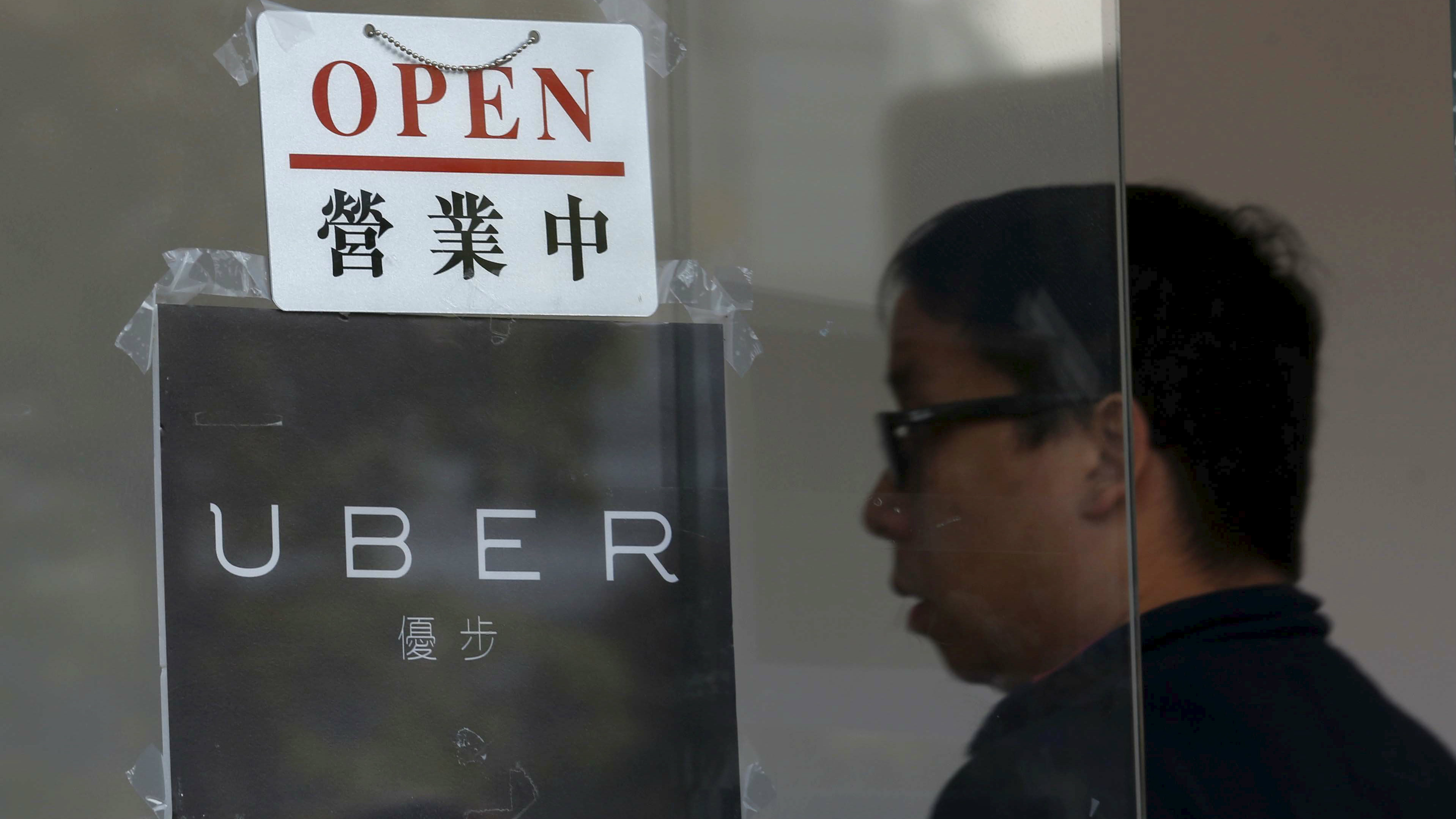 An open sign is seen at the office of taxi-hailing service Uber Inc during a driver recruitment event in Hong Kong, China December 29, 2015.