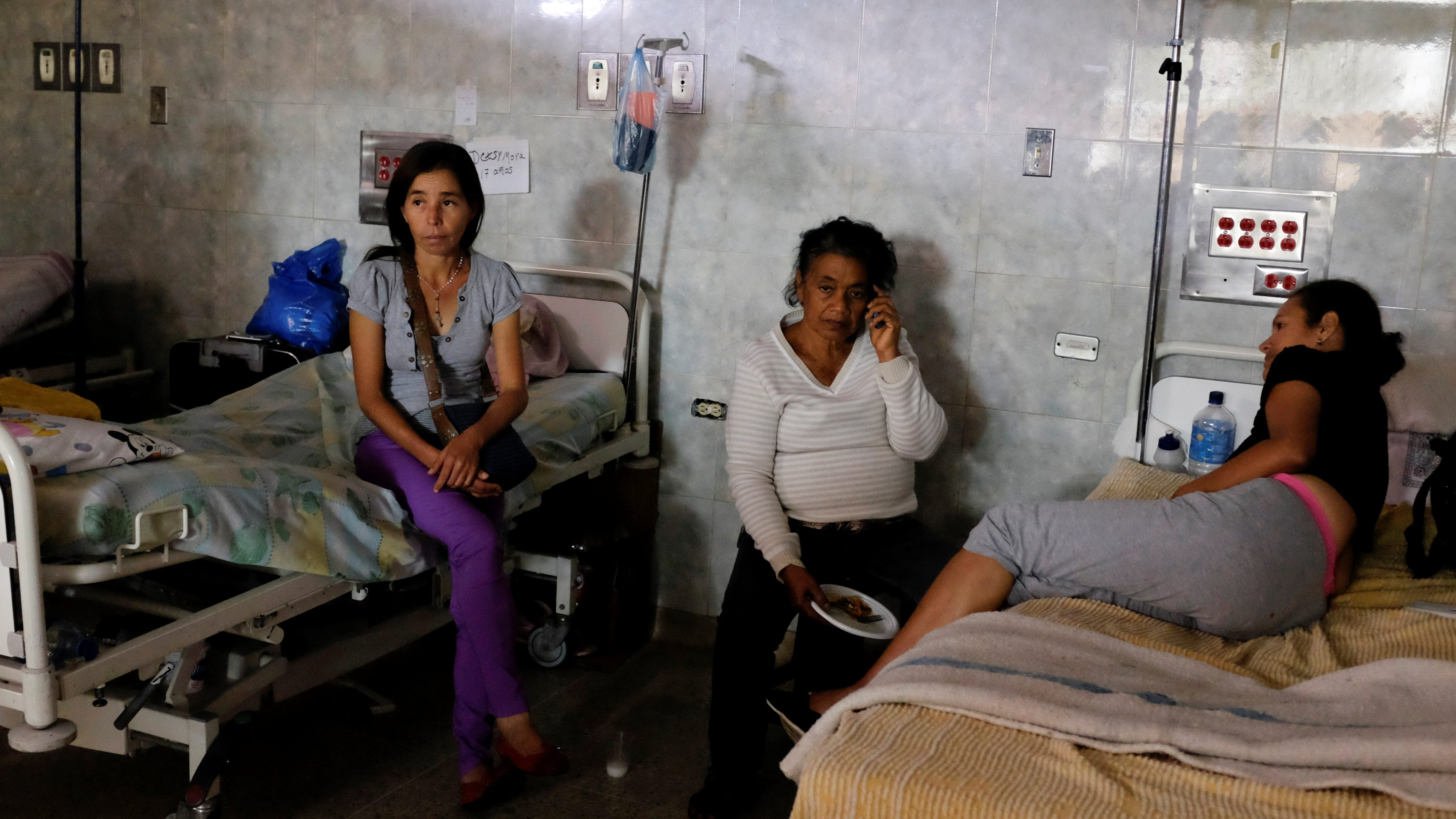 Patients lie on beds at the Universitary Hospital in Venezuela