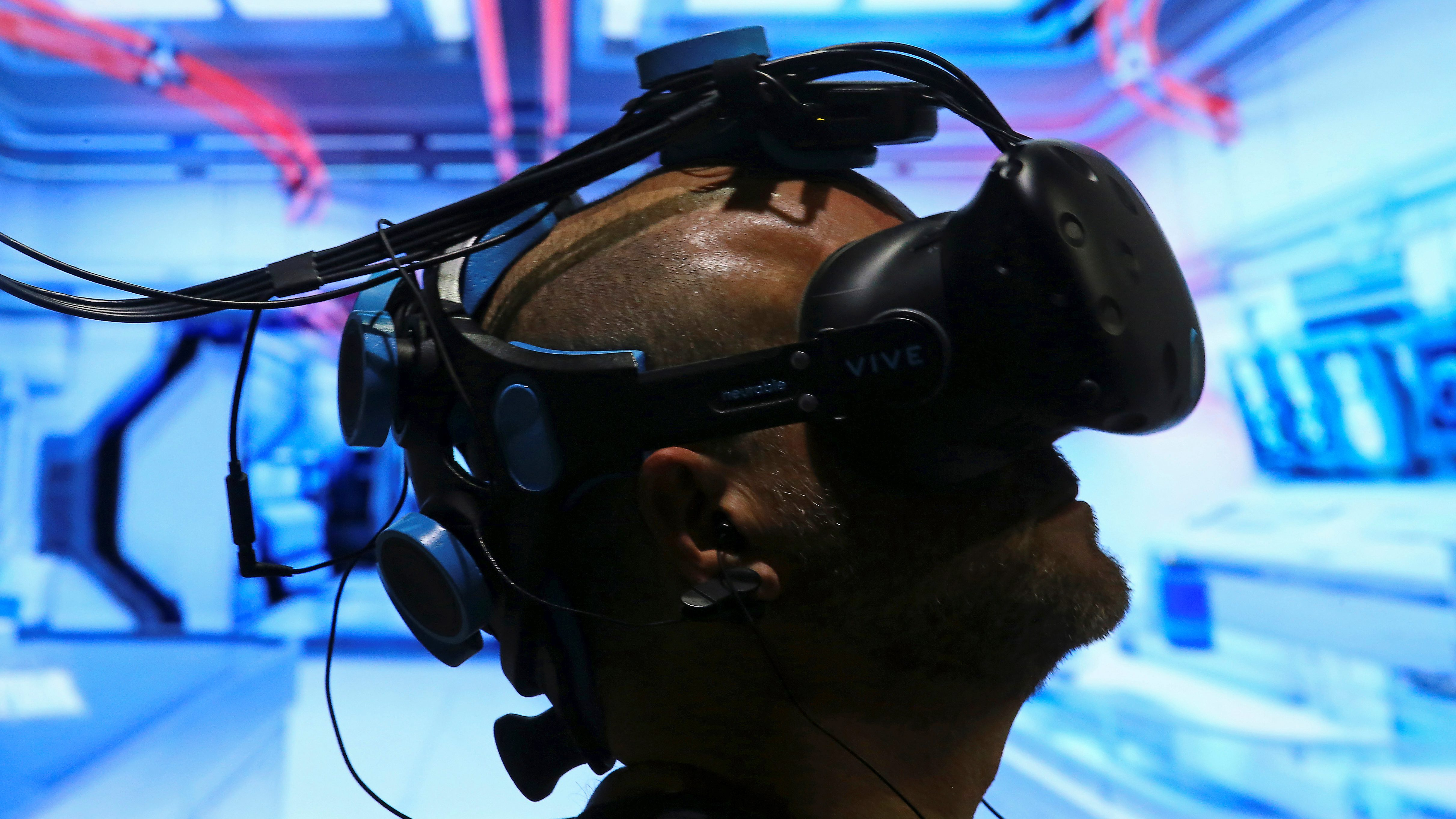 Pablo Holcer tests out a virtual reality system made by Neurable that allows the user to control with their thoughts as the EEG headset interprets thoughts into actions in the VR environment at SIGGRAPH 2017 in Los Angeles, California U.S. July 31, 2017.