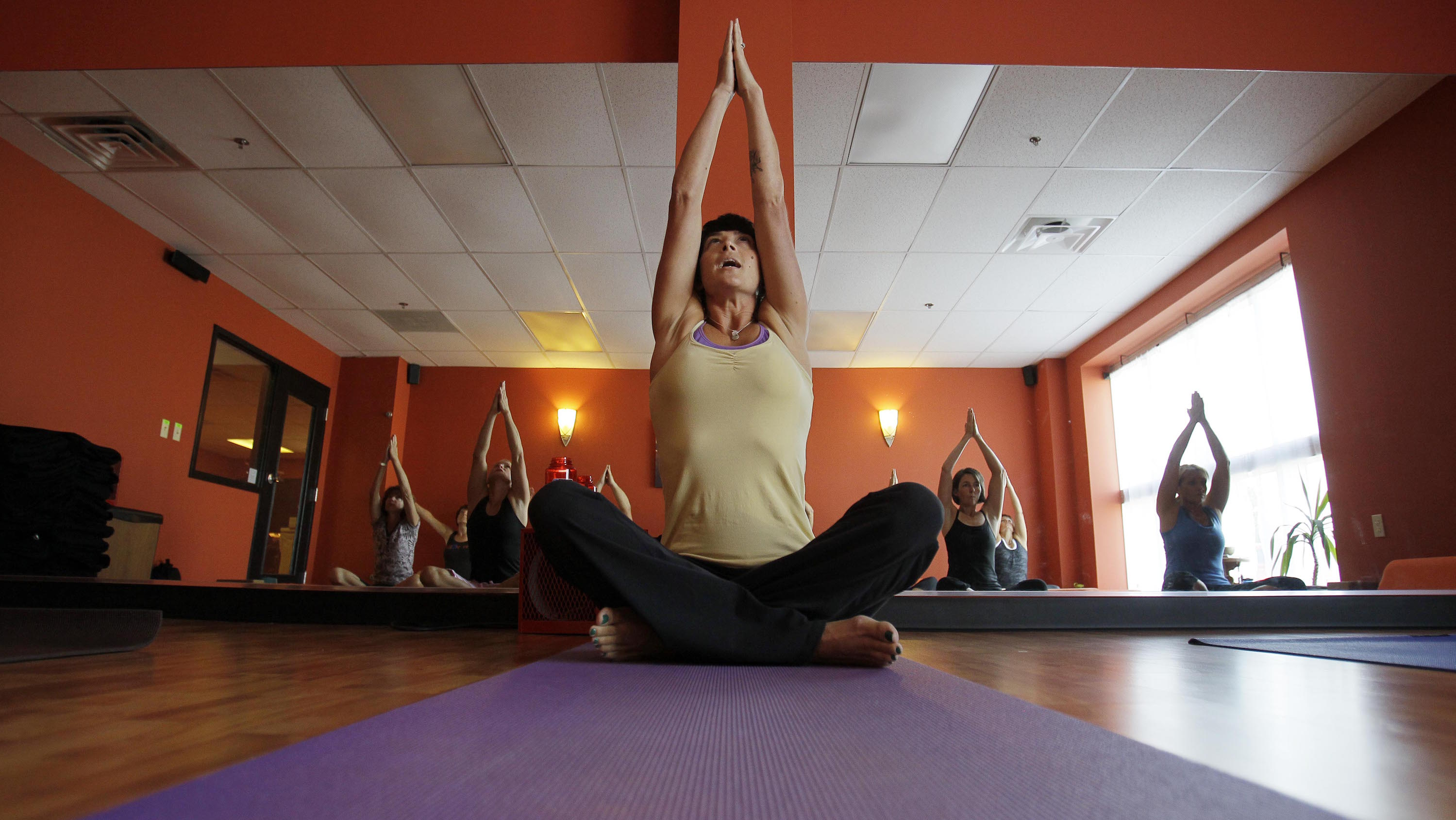 In this Friday, Sept. 24, 2010, photo Stephanie Dillon conducts a yoga class in Louisville, Ky. Dillon's practice of yoga puts her at odds with Southern Baptist Seminary President Albert Mohler who feels it is not a Christian pathway to God. (AP Photo/Ed Reinke)