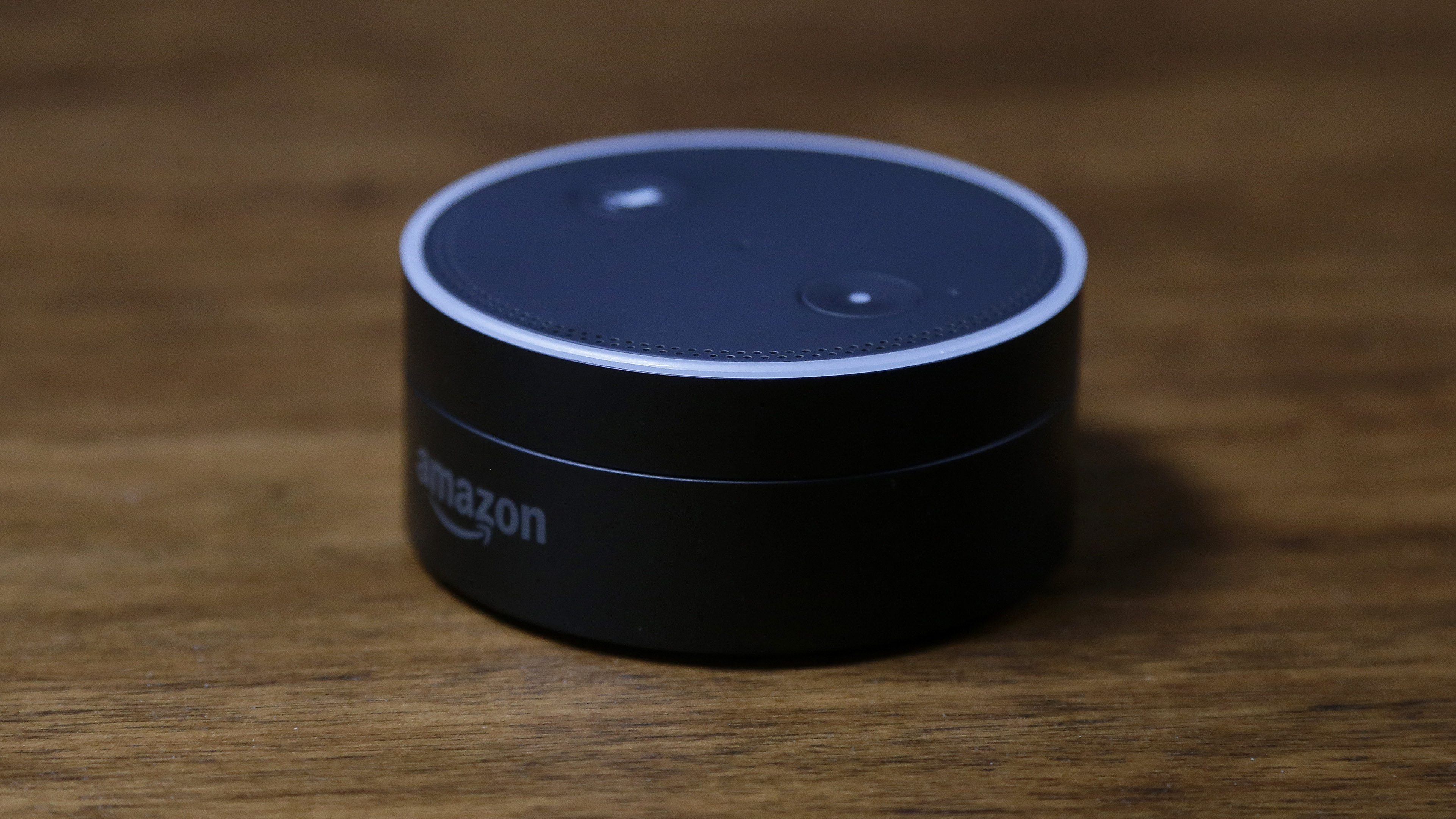 This March 2, 2016 photo shows an Echo Dot in San Francisco. Amazon.com is introducing two devices, the Amazon Tap and Echo Dot, that are designed to amplify the role that its voice-controlled assistant Alexa plays in people's homes and lives. (AP Photo/Jeff Chiu)