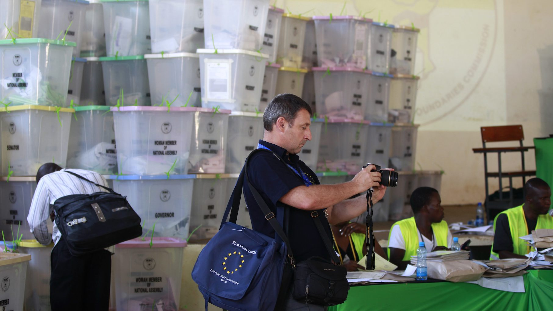 An election observer from the European Union takes pictures of the tallying centre during the presidential and parliamentary elections in Kisumu.