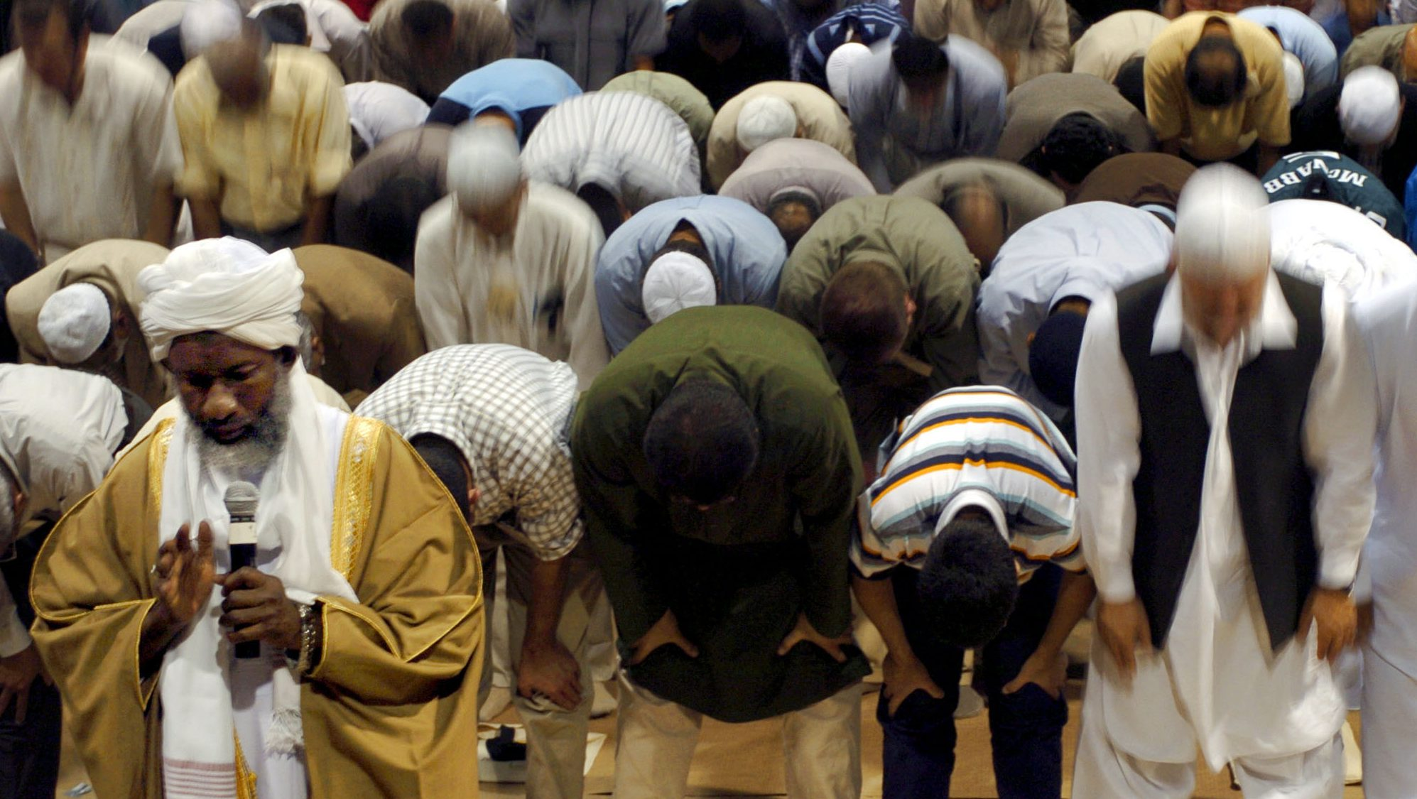 President of the Islamic Society of North America, Muhammad Nur Abdullah, front left, leads Muslims in prayer during the first day of the 41st Annual ISNA Convention Friday, Sept. 3, 2004, in Rosemont, Ill. (AP Photo/Jeff Roberson)
