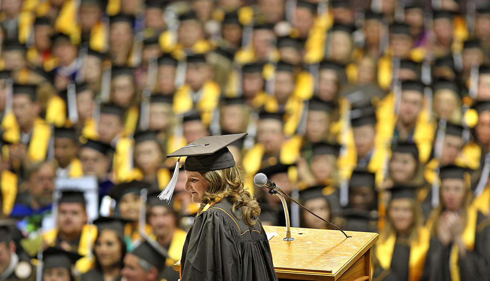 Kelsey Day, one of the 2009 College of Arts and Sciences outstanding graduates walks away from the podium after giving the A&S Commencement speech in the Arena-Auditorium in Laramie, Wyo. on Saturday, May 9, 2009.  (AP Photo/Laramie Boomerang, Ben Woloszyn)