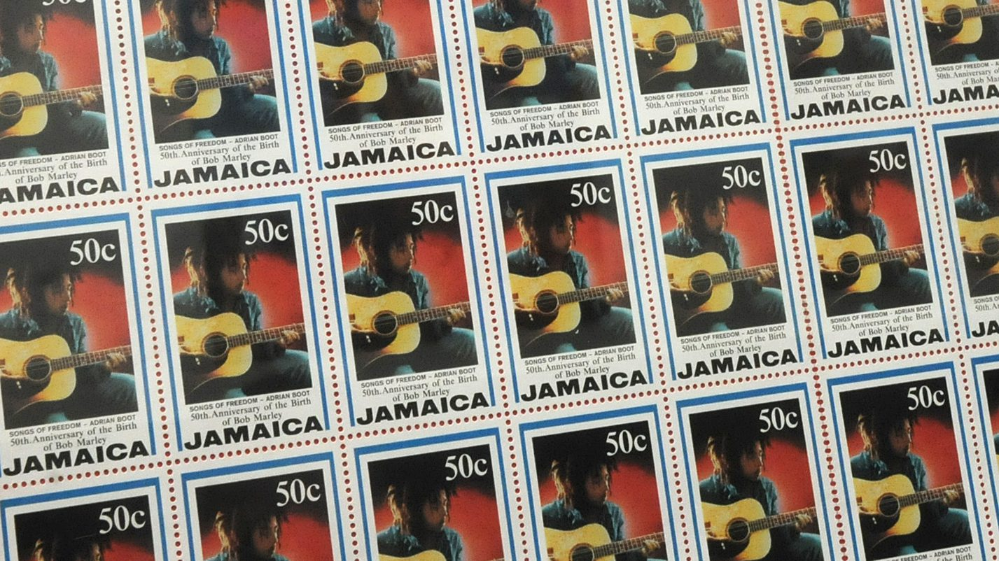 This June 16, 2009 photo shows postal stamps bearing the image of Bob Marley displayed inside Tuff-Gong Studios, where Marley recorded some of his best-known songs in the capital Kingston. This year, Marley's family, with the help of a private equity firm and a team of lawyers, are trying to wrestle control of all rights to Marley's ubiquitous image from merchandise counterfeiters doing an estimated $600 million in annual sales across the globe. (AP Photo/Michael Sloley)