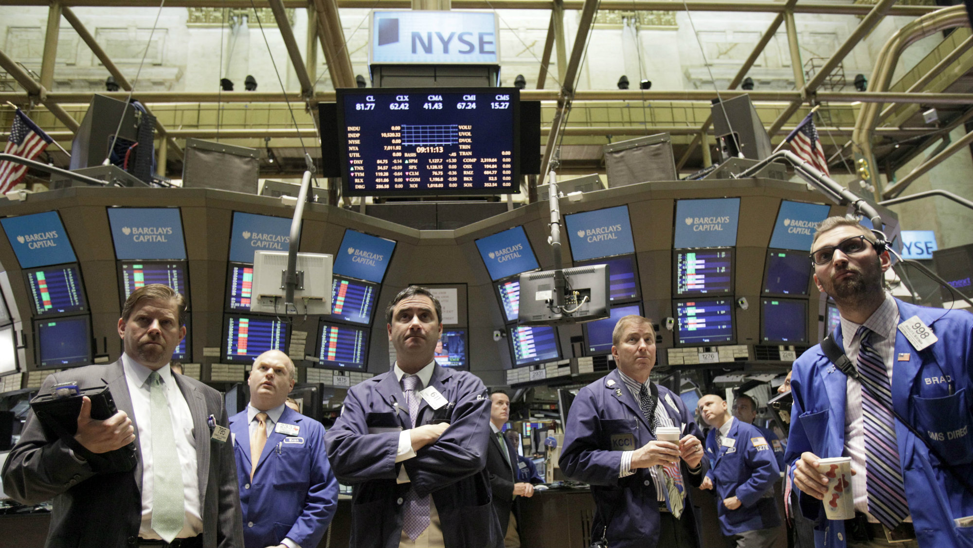 Traders gather on the floor of the New York Stock Exchange