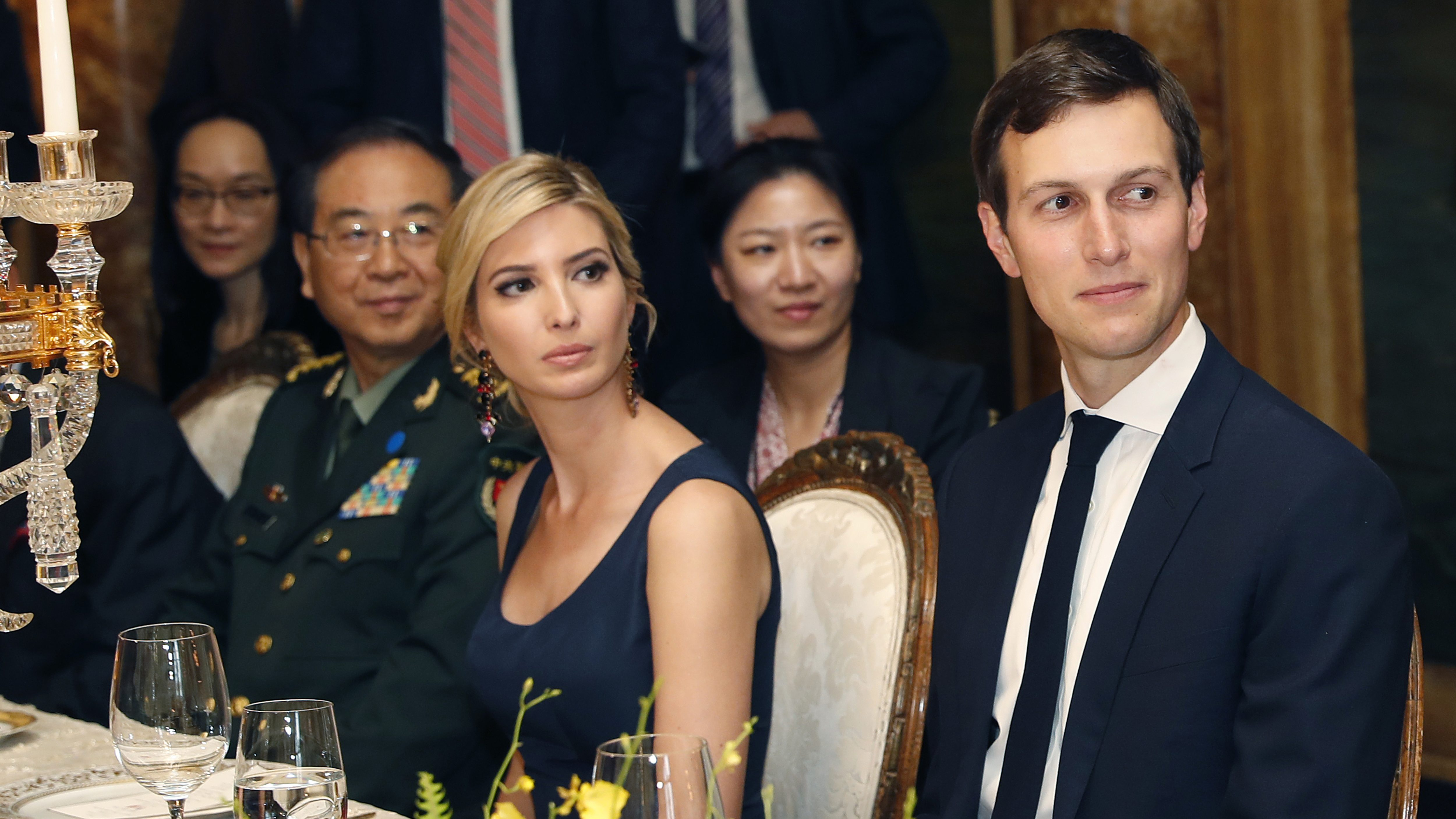 FILE - In this Thursday, April 6, 2017, file photo, Ivanka Trump, center, daughter and assistant to U.S President Donald Trump, is seated with her husband, White House senior adviser Jared Kushner, right, during a dinner with President Donald Trump and Chinese President Xi Jinping, at Mar-a-Lago, in Palm Beach, Fla. China has granted provisional approval for four additional Ivanka Trump trademarks since April 20, and her brand has continued to seek more intellectual property protection in China, with at least 14 applications filed around the time she took on an official White House role, Chinese public records show. (AP Photo/Alex Brandon, File)