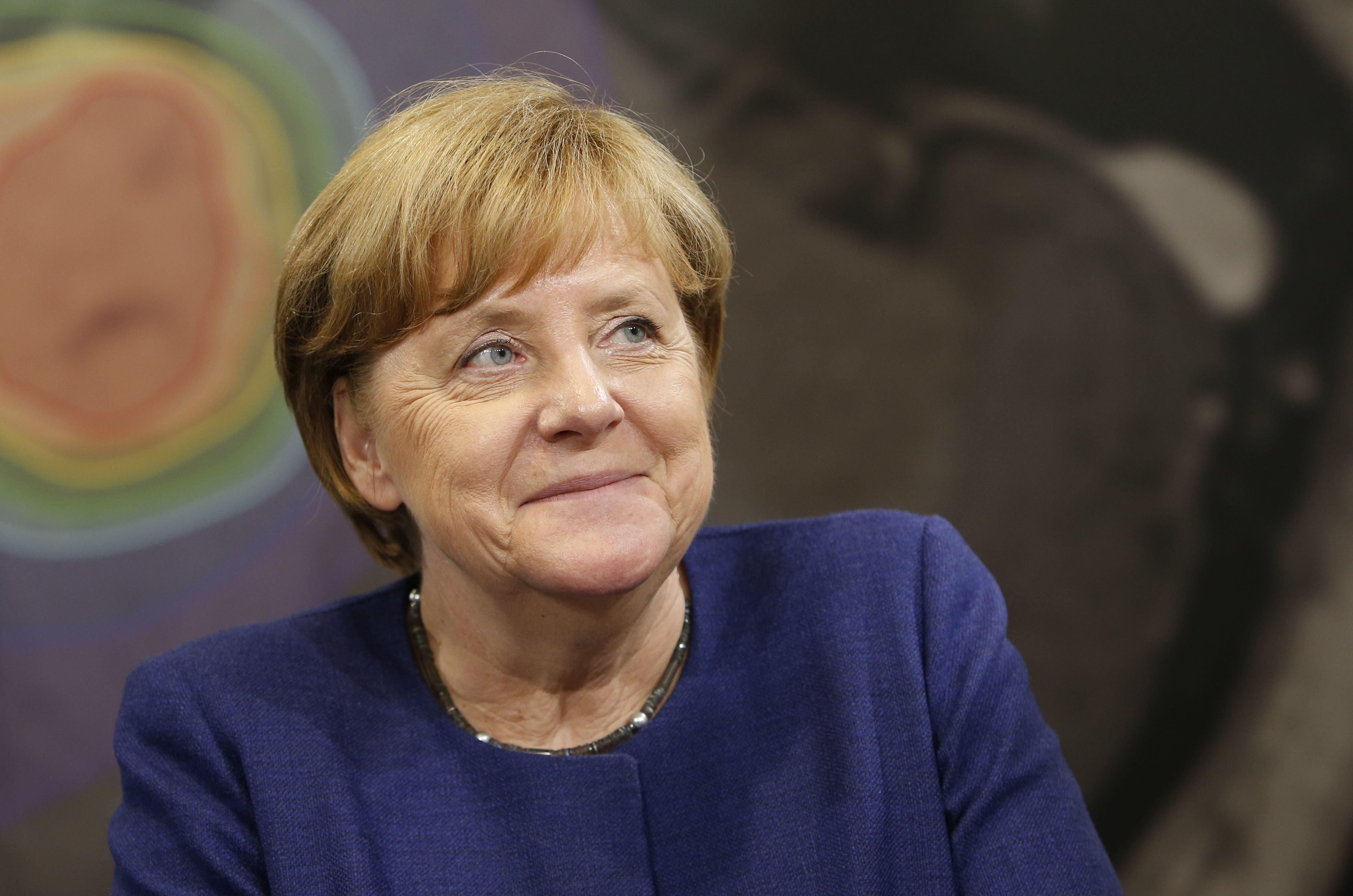 German Chancellor Angela Merkel, attends the official opening of Brainlab headquarters in Munich, Germany Tuesday, July 11, 2017.   (Michaela Rehle/Pool Photo via AP)