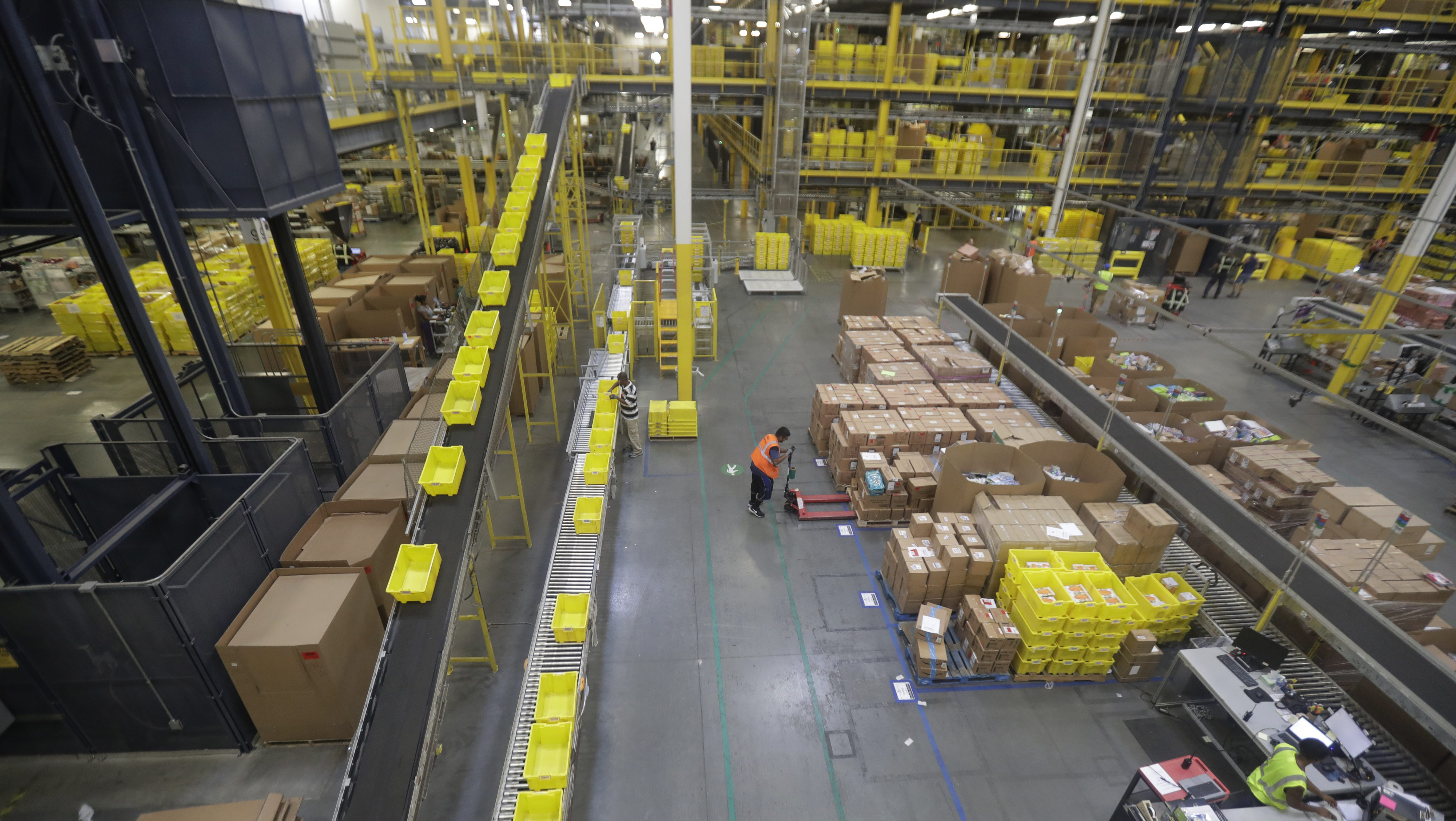 General scenes inside the Amazon Fulfillment center in Robbinsville Township, N.J., Tuesday, Aug. 1, 2017. Amazon held a nation-wide job fair at its warehouses on Aug. 2. (AP Photo/Julio Cortez)