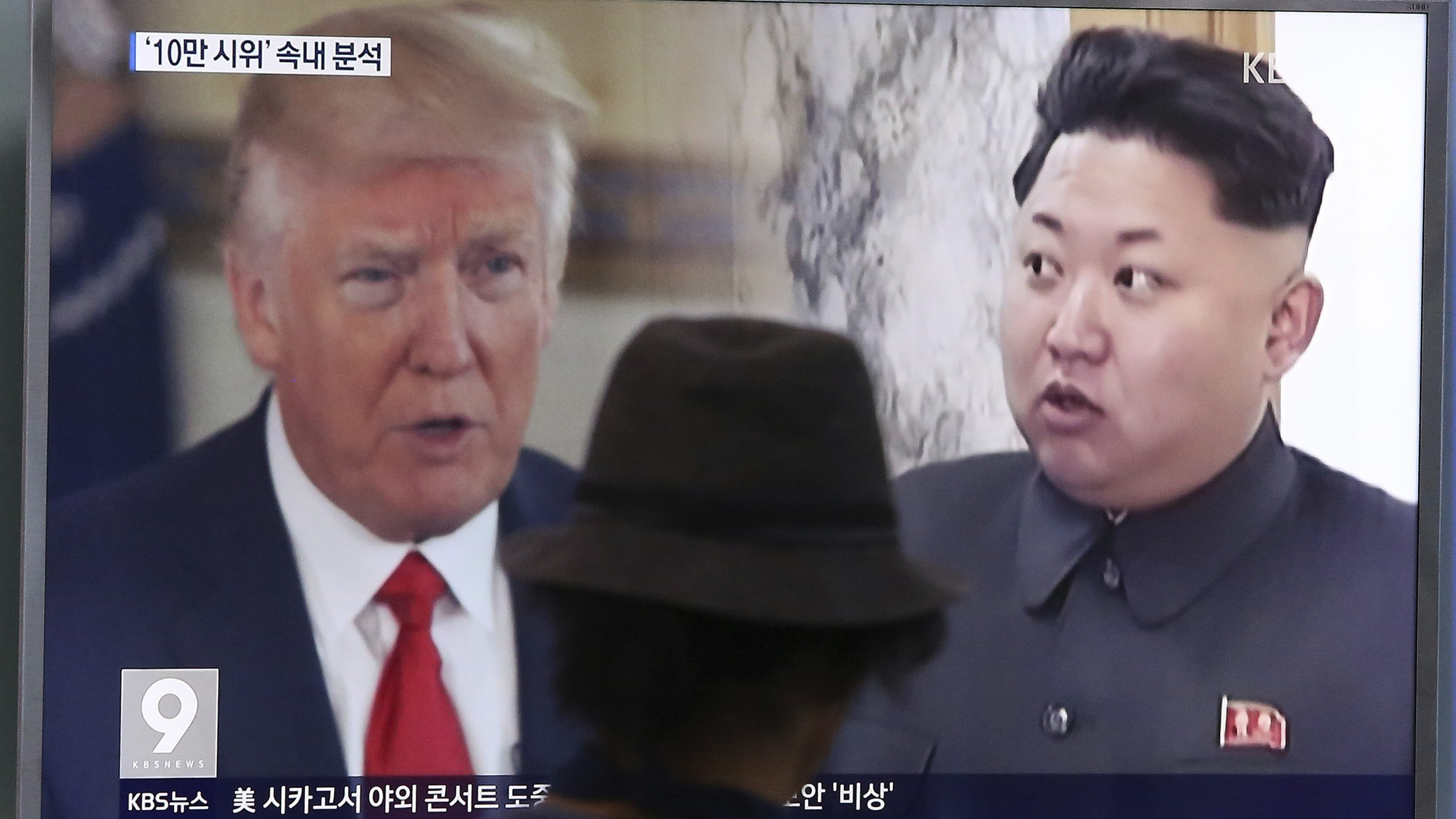 In this Thursday, Aug. 10, 2017, file photo, a man watches a television screen showing U.S. President Donald Trump, left, and North Korean leader Kim Jong Un during a news program at the Seoul Train Station in Seoul, South Korea. North Korea has announced a detailed plan to launch a salvo of ballistic missiles toward the U.S. Pacific territory of Guam, a major military hub and home to U.S. bombers. If carried out, it would be the North's most provocative missile launch to date.
