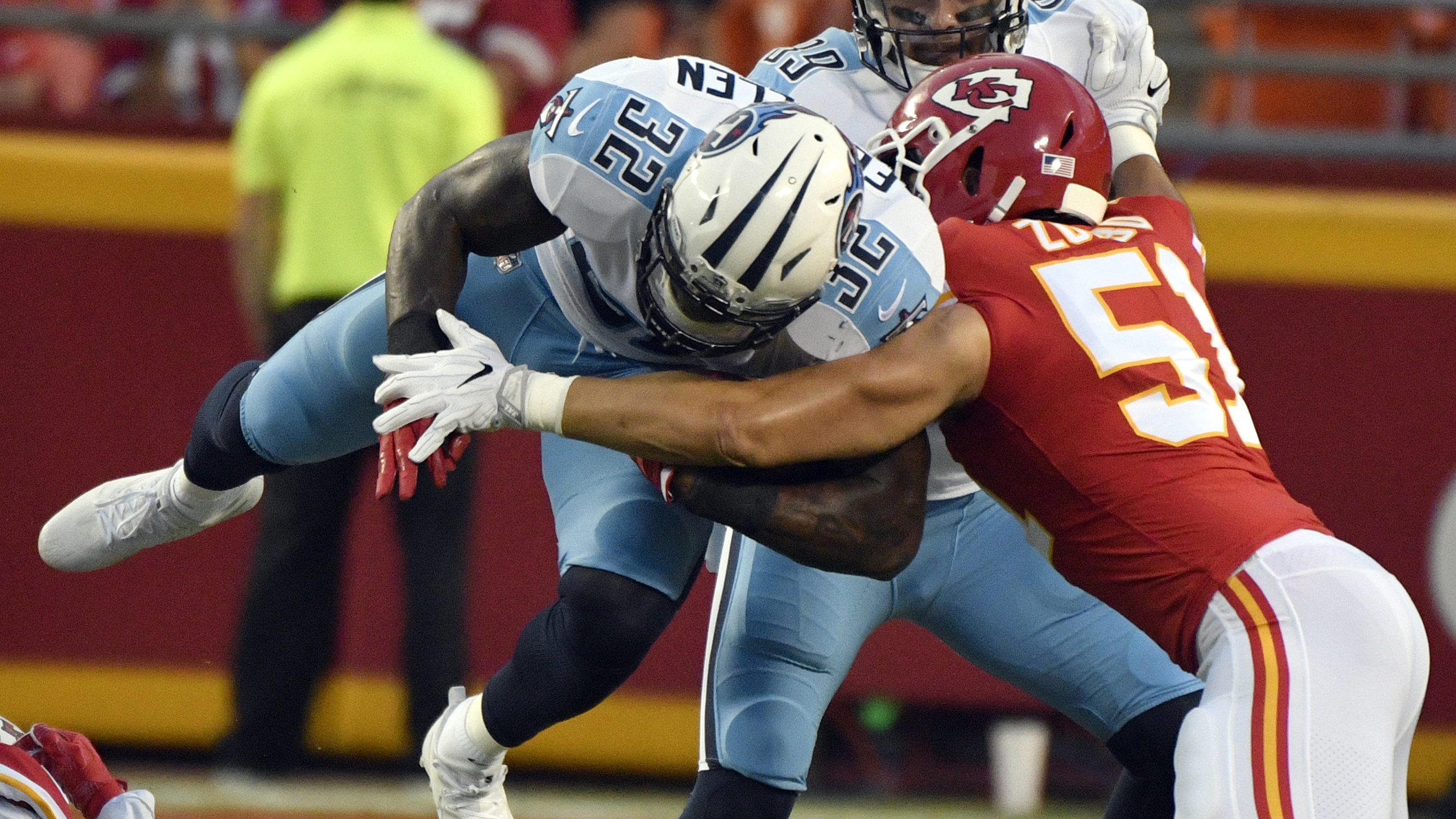 Tennessee Titans running back David Fluellen (32) is stopped by Kansas City Chiefs linebacker Frank Zombo (51) during the first half of an NFL preseason football game in Kansas City, Mo., Thursday, Aug. 31, 2017. (AP Photo/Ed Zurga)