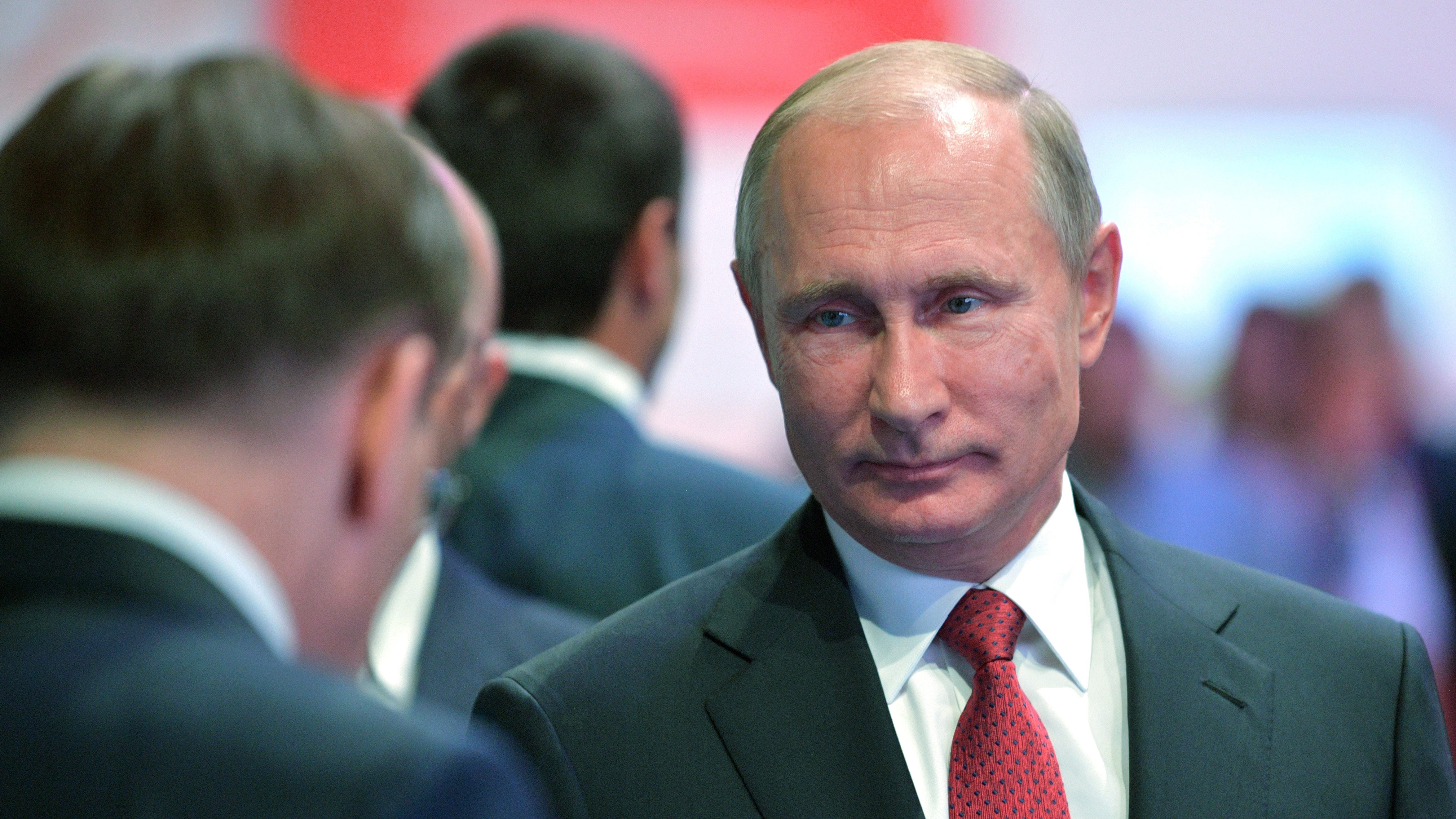 """Russian President Vladimir Putin, right, attends a meeting with students in Yaroslavl, Russia, Friday, Sept. 1, 2017. Putin said that whoever reaches a breakthrough in developing artificial intelligence will come to dominate the world. Putin, speaking Friday at a meeting with students, said the development of AI raises """"colossal opportunities and threats that are difficult to predict now.""""  (Alexei Druzhinin, Kremlin Pool Photo via AP)"""