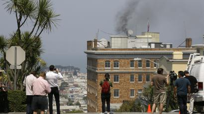 Black smoke coming from the roof of the Consulate-General of Russia Friday, Sept. 1, 2017, in San Francisco. The San Francisco Fire Department says acrid, black smoke seen pouring from a chimney at the Russian consulate in San Francisco was apparently from a fire burning in a fireplace. The smoke was seen billowing from the consulate building a day after the Trump administration ordered its closure. (AP Photo/Eric Risberg)