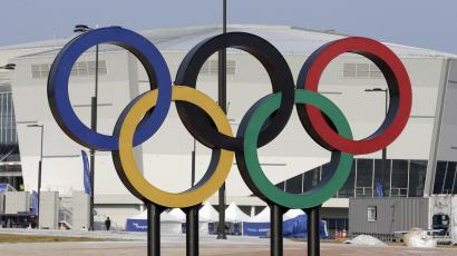 In this April 4, 2017, file photo, Olympic rings are seen in front of Gangneung Hockey Center in Gangneung, South Korea. With five months to go before the opening ceremony of the Pyeongchang Winter Olympics, organizers are desperate to sell more tickets in a country where the Games have failed to dominate national conversation amid an upheaval in domestic politics and a torrent of North Korean missile launches.