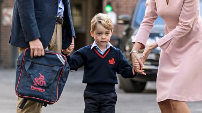 Prince George arrive for his first day of school at Thomas's school in Battersea and is met by Helen Haslem head of the lower school.