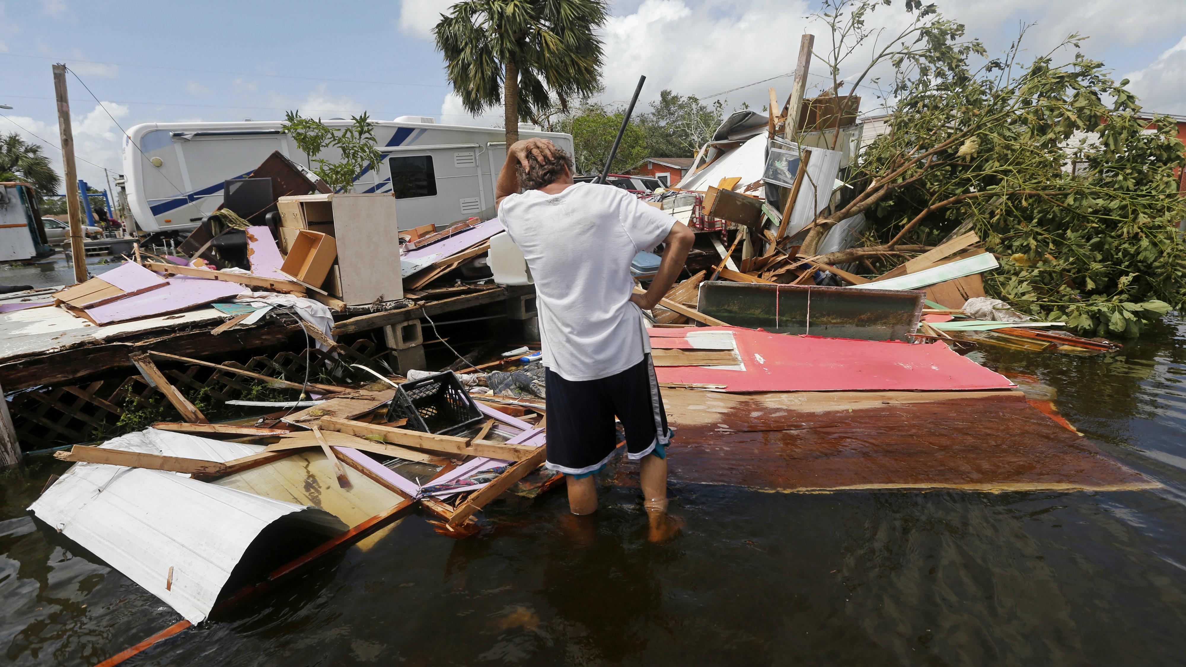 Man assessing damage of Hurricane Irma.