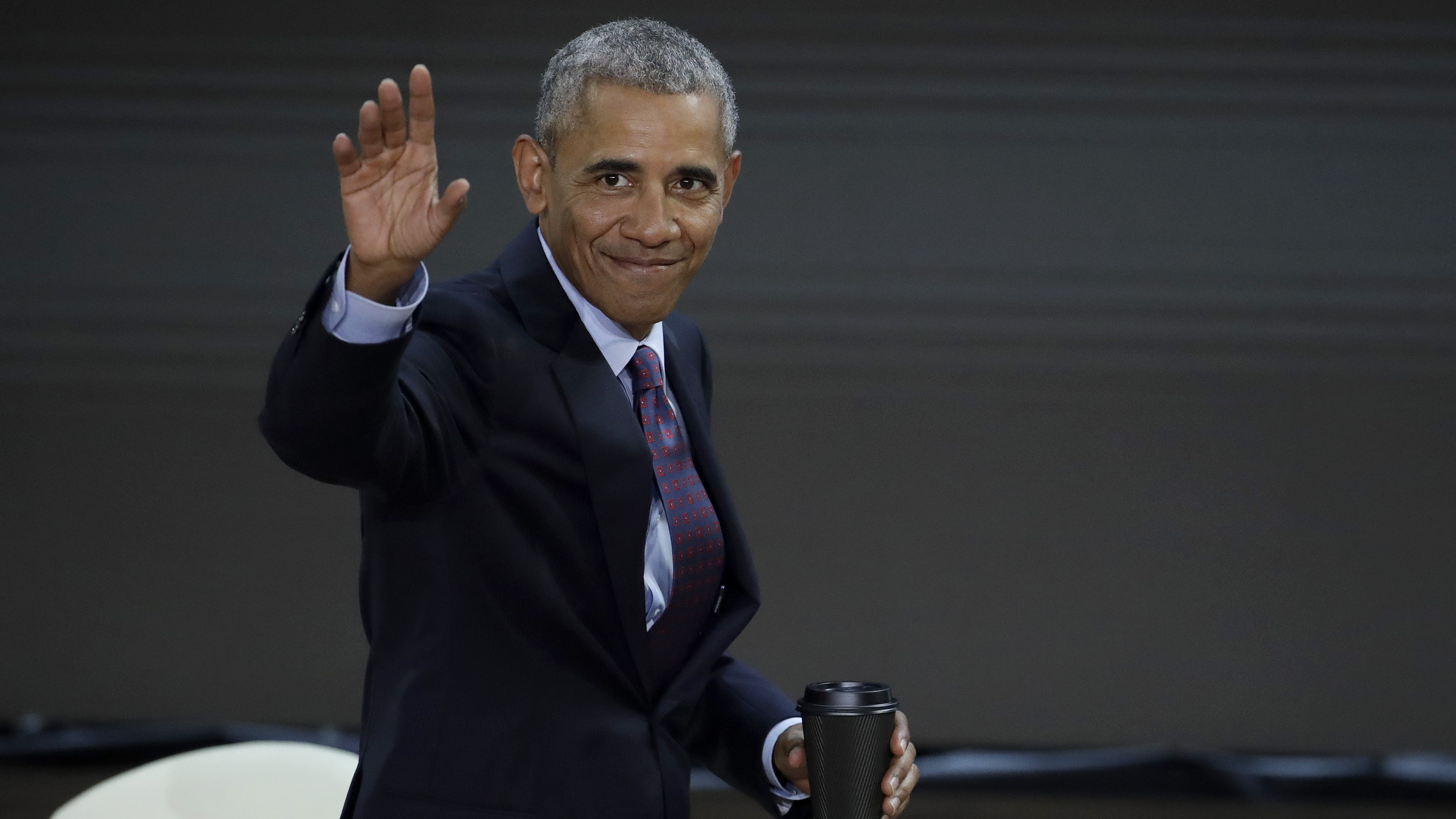 Former President Barack Obama waves as he leaves the stage after speaking during the Goalkeepers Conference hosts by the Bill and Melinda Gates Foundation, Wednesday, Sept. 20, 2017, in New York. (AP Photo/Julio Cortez)