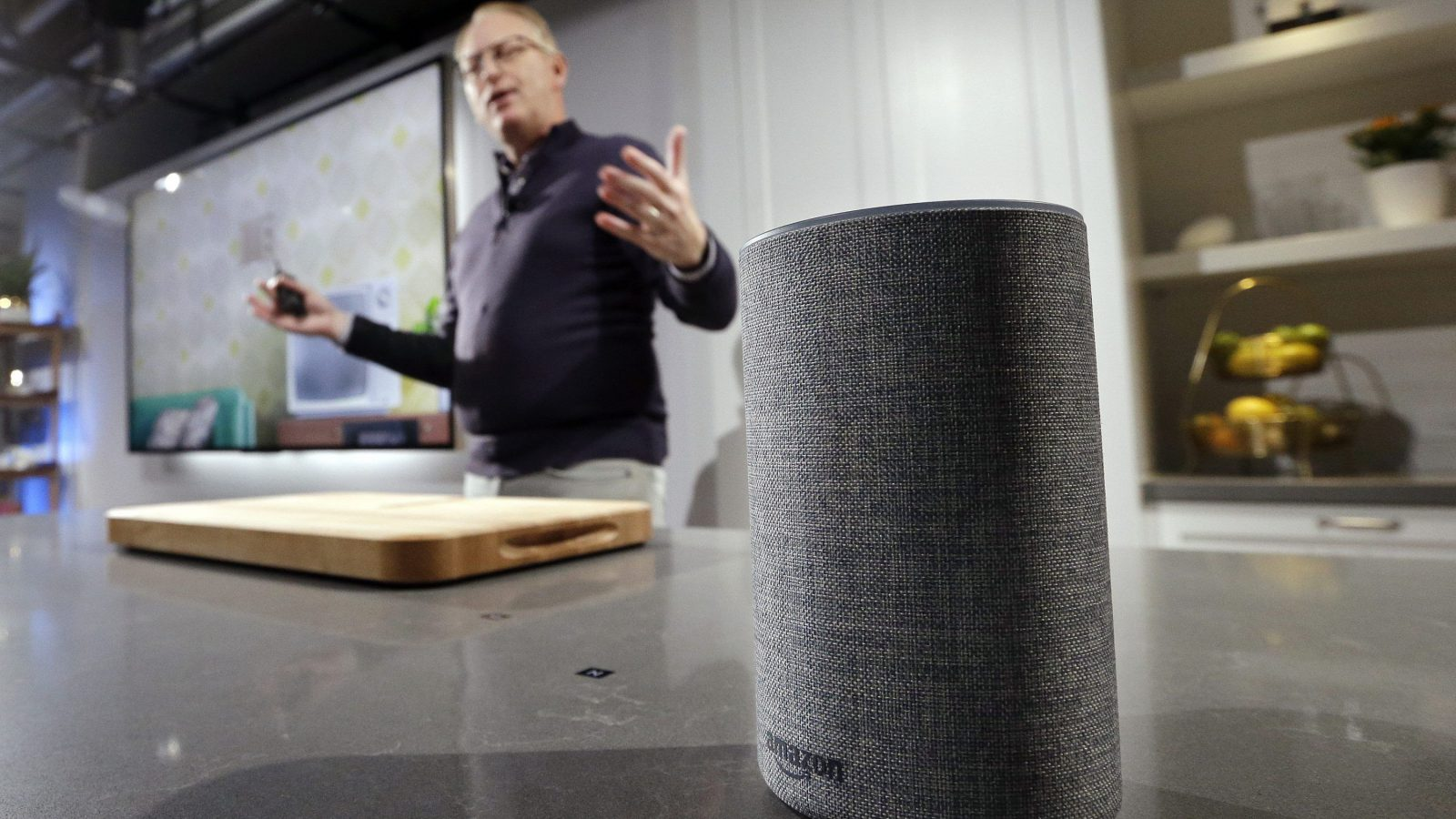 "A new Amazon Echo is displayed during a program announcing several new Amazon products by the company, Wednesday, Sept. 27, 2017, in Seattle. Amazon says it is cutting the price of its Echo smart speaker to $100 from $180, improving the sound quality and upgrading its appearance with six new ""shells."" The next generation speaker, which is powered by Amazon's Alexa voice assistant, will have a dedicated woofer and a tweeter for the first time, as well as Dolby sound."