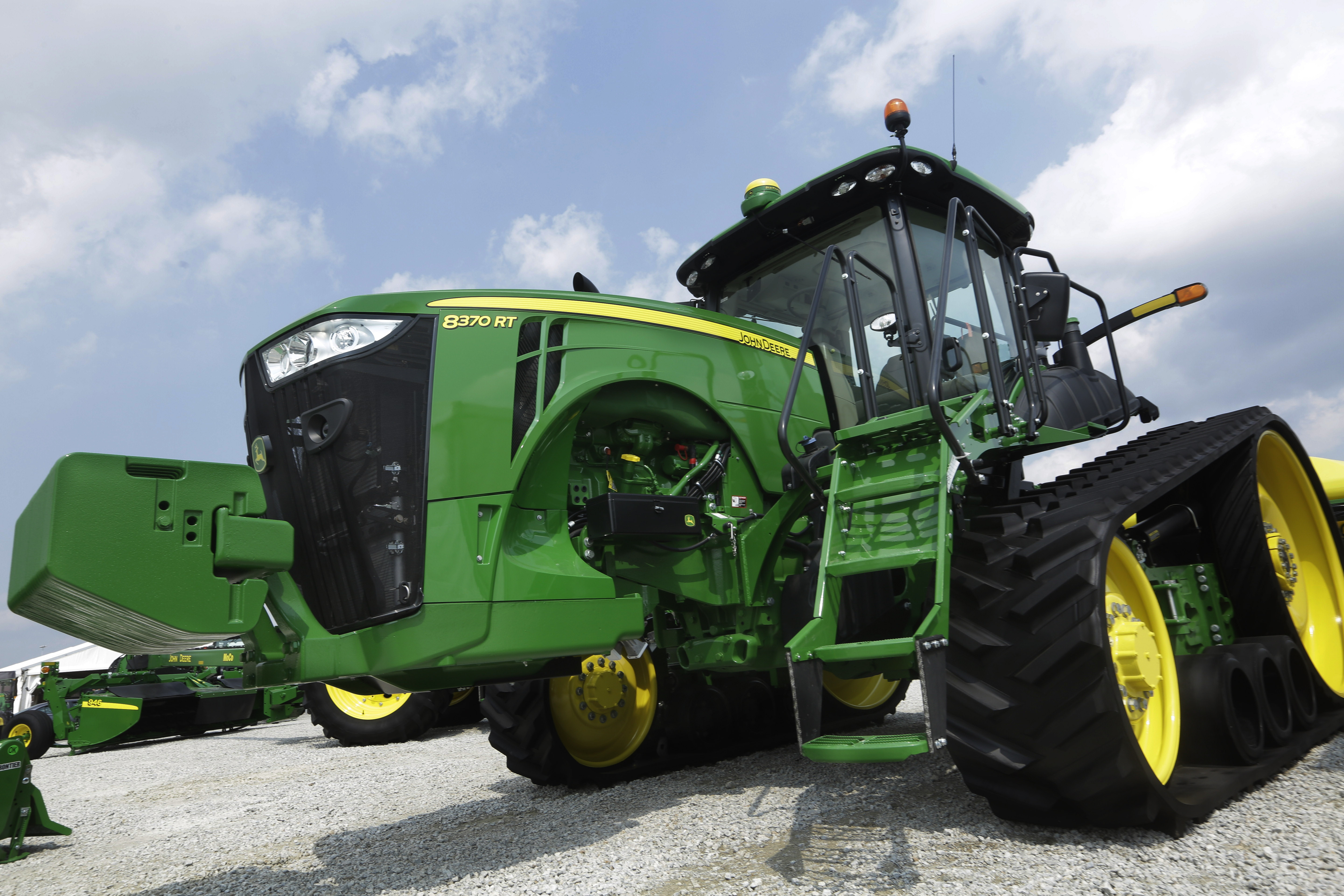 In this Monday, Aug. 31, 2015 photo, John Deere equipment is on display at the Farm Progress Show in Decatur, Ill. (AP Photo/Seth Perlman)