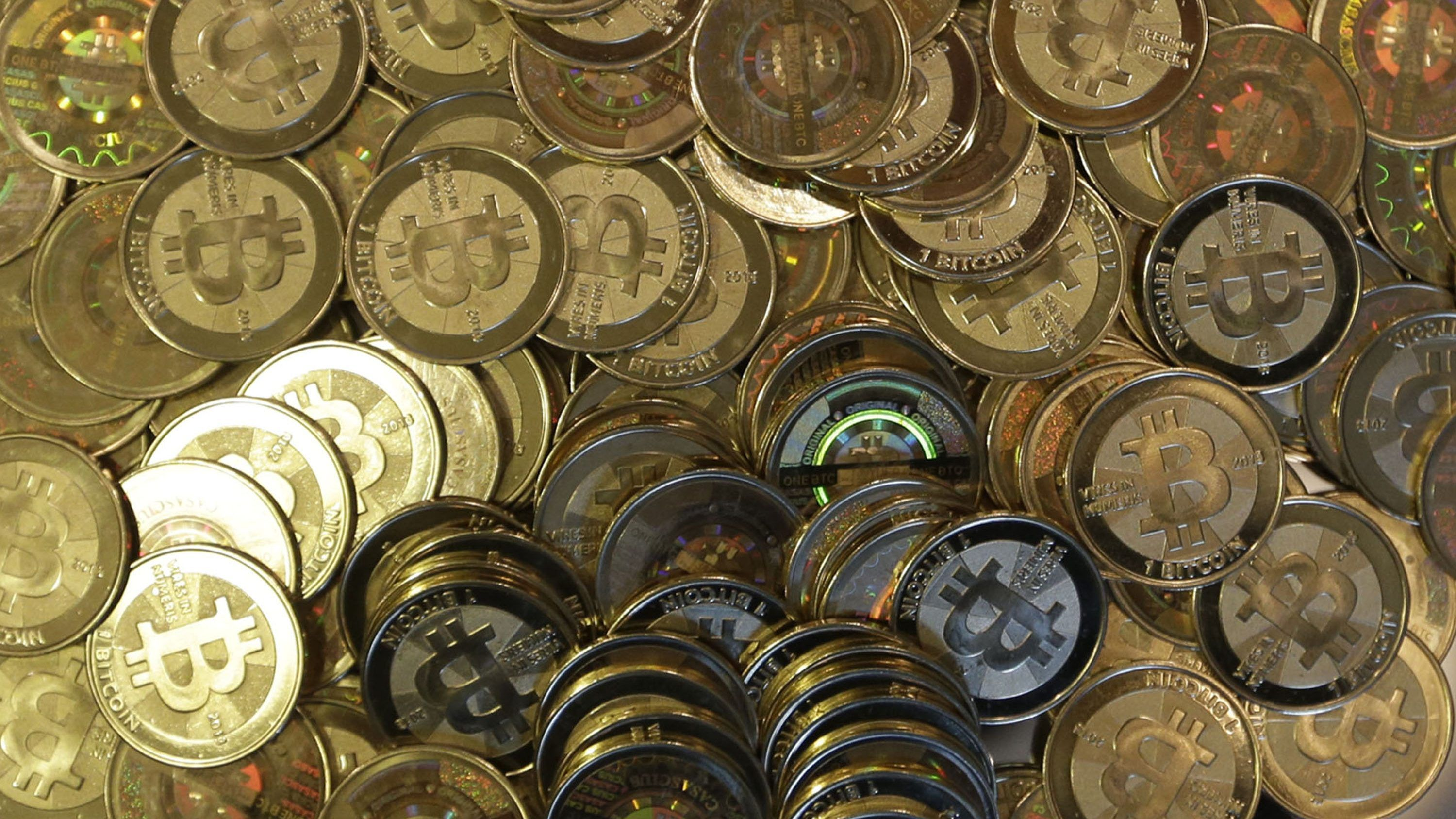 This April 3, 2013 photo shows bitcoin tokens at 35-year-old software engineer Mike Caldwell's shop in Sandy, Utah. Caldwell mints physical versions of bitcoins, cranking out homemade tokens with codes protected by tamper-proof holographic seals, a retro-futuristic kind of prepaid cash. With up to 70,000 transactions each day over the past month, bitcoins have been propelled from the world of Internet oddities to the cusp of mainstream use, a remarkable breakthrough for a currency which made its online debut only four years ago.