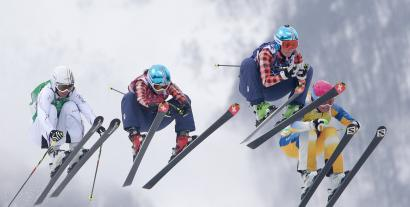France's Ophelie David, from left, Canada's Kelsey Serwa, Canada's Marielle Thompson and Sweden's Anna Holmlund compete during their ski cross final at the 2014 Winter Olympics, Friday, Feb. 21, 2014, in Krasnaya Polyana, Russia.