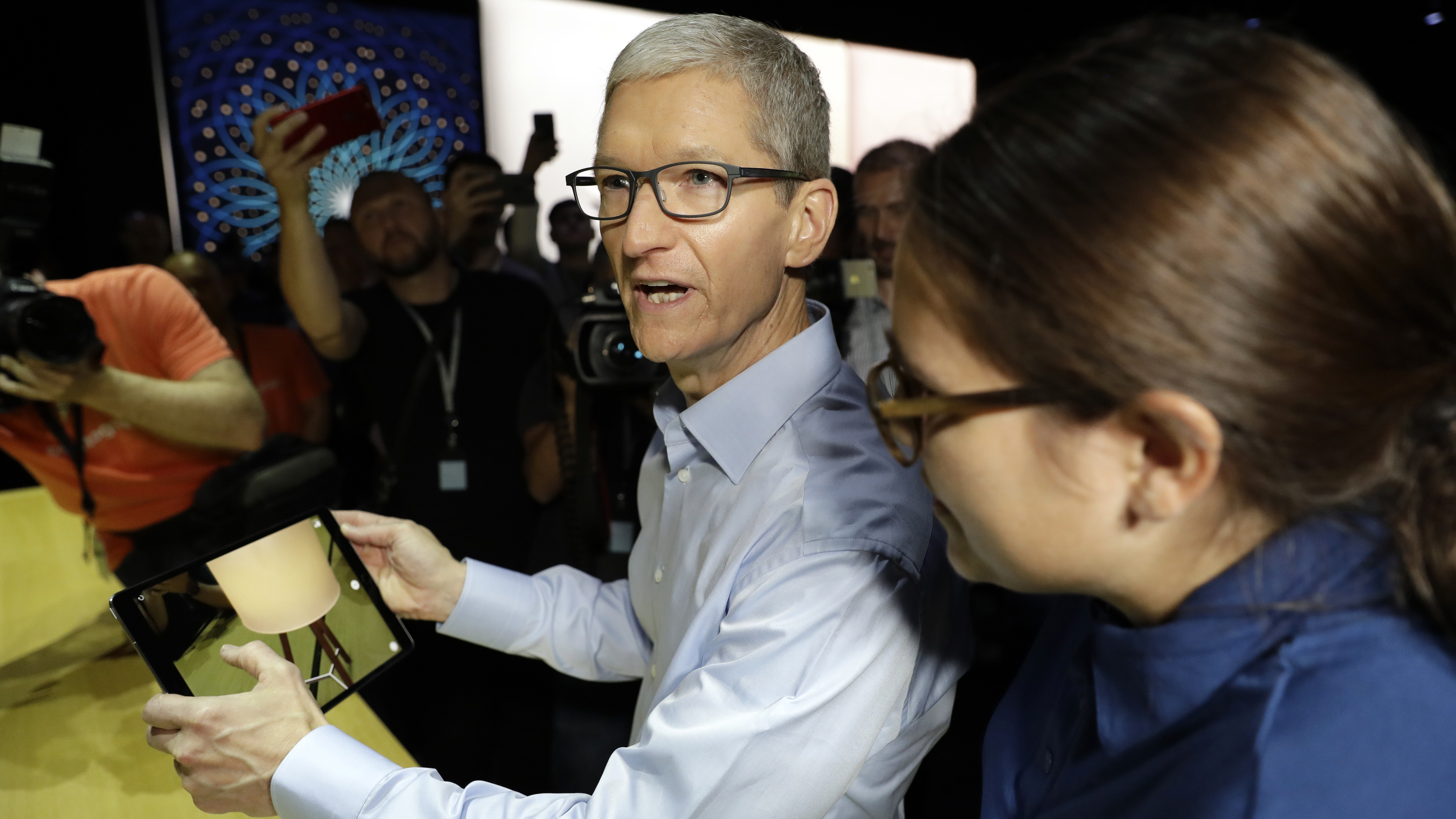 Apple CEO Tim Cook shows an iPad Pro during an announcement of new products at the Apple Worldwide Developers Conference Monday, June 5, 2017, in San Jose , Calif. (AP Photo/Marcio Jose Sanchez)