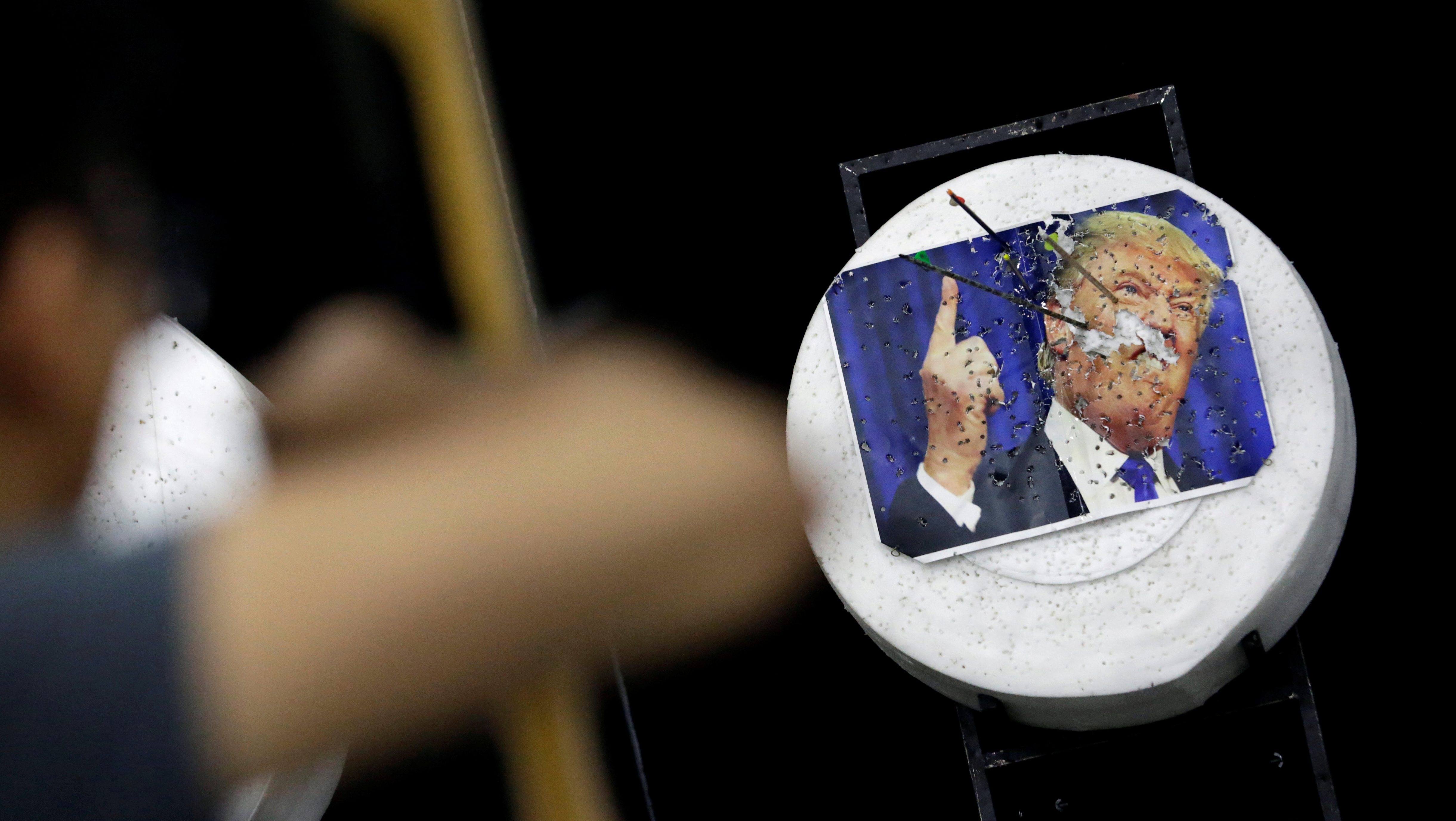 Arrows in a photo of U.S. President Donald Trump in Mexico