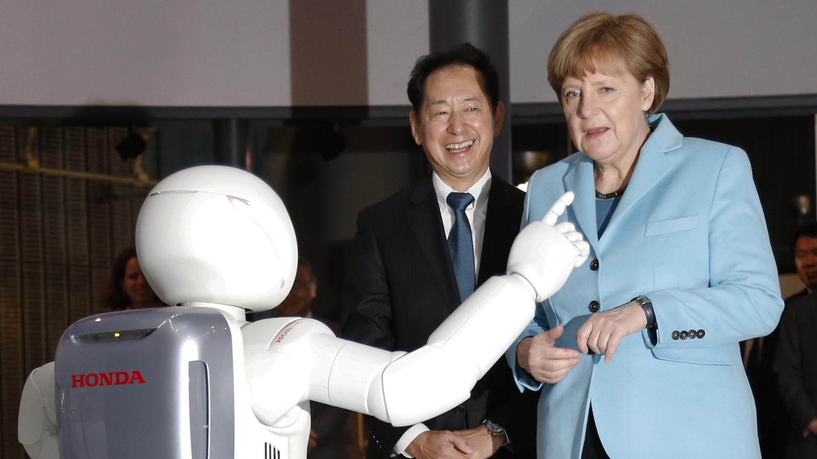angela merkel and robot asimo