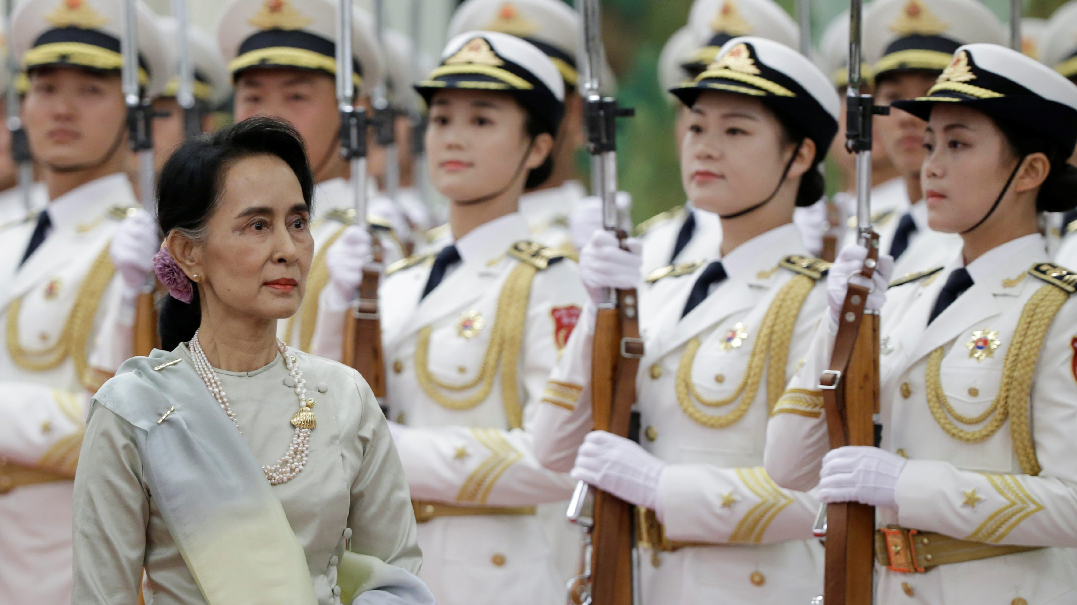 Myanmar State Counselor Aung San Suu Kyi reviews honour guards during a welcoming ceremony at the Great Hall of the People in Beijing, China, August 18, 2016. REUTERS/Jason Lee - S1AETWCTVVAA