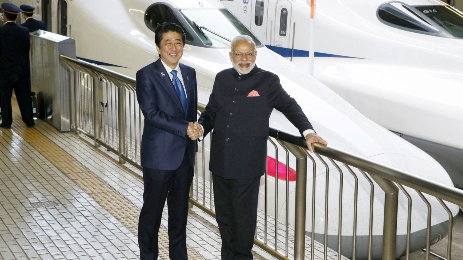 Indian Prime Minister Narendra Modi (R) and Japan's Prime Minister Shinzo Abe pose in front of a Shinkansen bullet train before heading for Hyogo prefecture at Tokyo Station, Japan November 12, 2016, in this photo taken by Kyodo. Mandatory credit