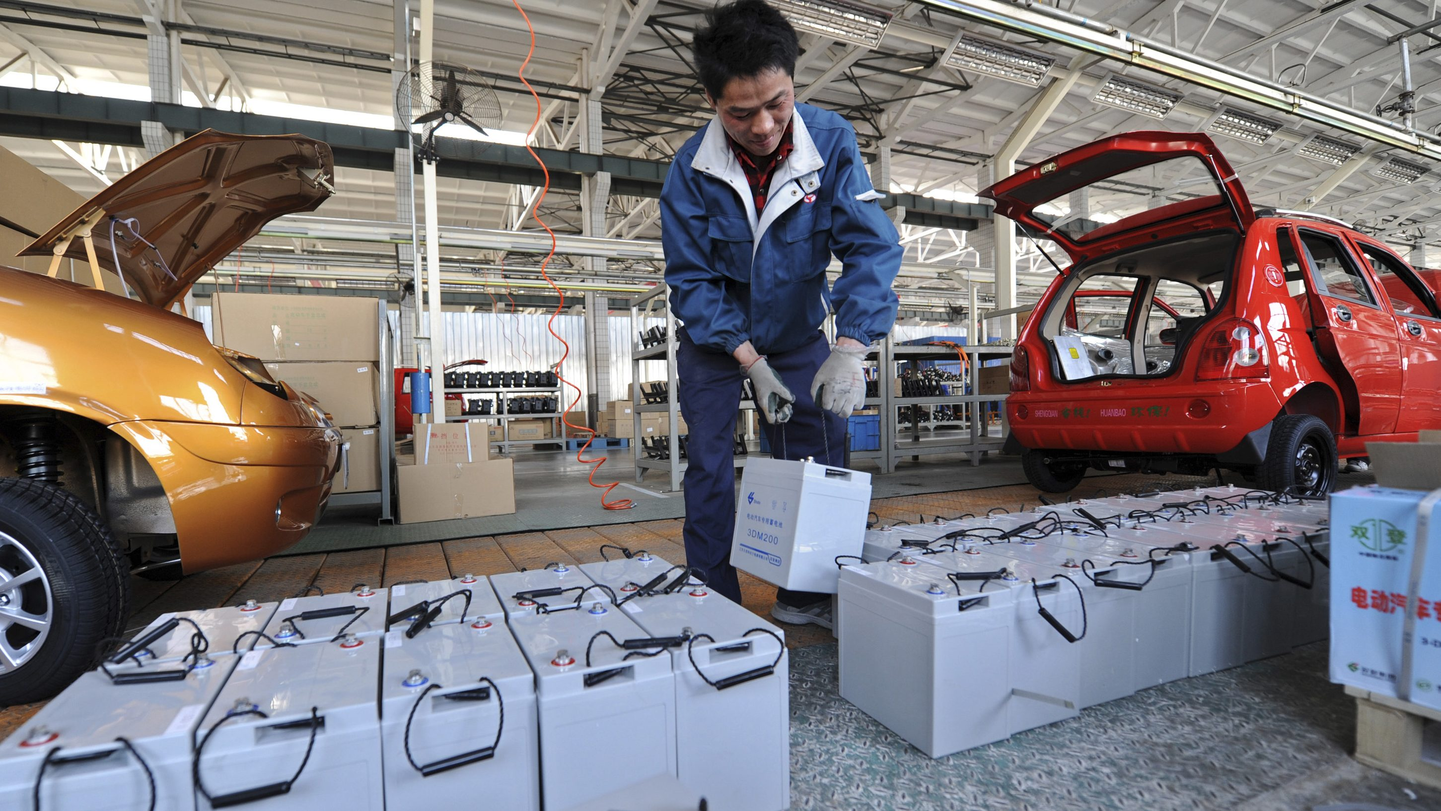 A employee carries a battery as he works on an assembly line of electric cars at a factory of Shandong Shifeng (Group) Co. Ltd. in Jinan, Shandong province April 6, 2012. Shifeng is the top player in the market, with about a 50 p ercent share. Shifeng delivered nearly 30,000 cars to its 200 dealer outlets across the country in 2011. Sales this year could hit 50,000, about a 13-fold increase over the level in 2008, the first full year of sales, said company vice president Lin Lianhua. Picture taken April 6, 2012.