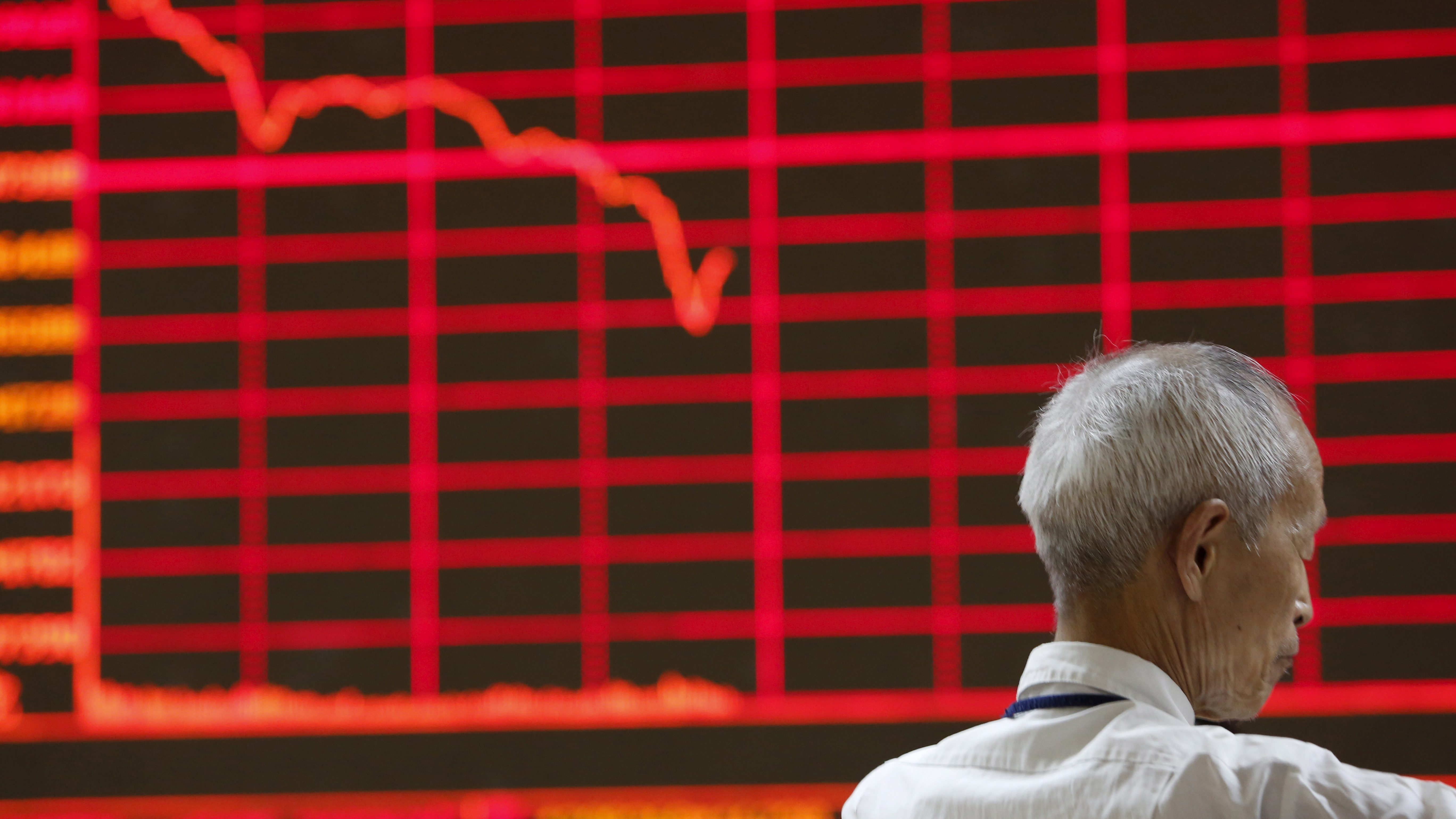 A man is seen in front of  a board showing a graph of stock prices at a brokerage office in Beijing, China, July 6, 2015. Chinese stocks rose on Monday after Beijing unleashed an unprecedented series of support measures over the weekend to stave off the prospect of a full-blown crash that was threatening to destabilise the world's second-biggest economy.