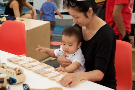 A young boy and his mom play with Learning Beautiful's binary cards at the Chicago Public Library.